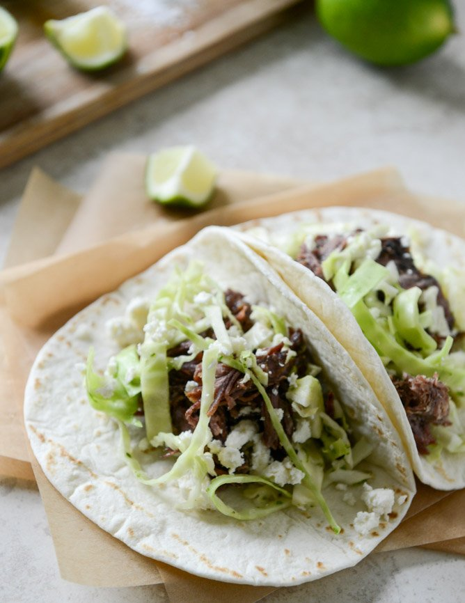 Crockpot Short Rib Tacos with Salted Lime Cabbage and Queso Fresco I howsweeteats.com