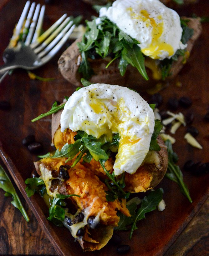 Cheesy Black Bean Stuffed Sweet Potatoes with Arugula + Poached Eggs I howsweeteats.com