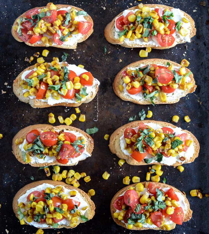 Grilled Corn + Tomato Crostini with Whipped Roasted Garlic Goat Cheese