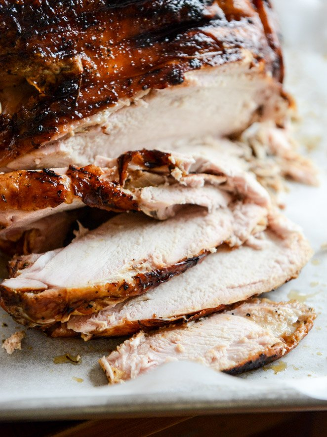 this applewood smoked turkey is prepped with a maple bourbon brine and served with a cider bourbon gravy! I howsweeteats.com