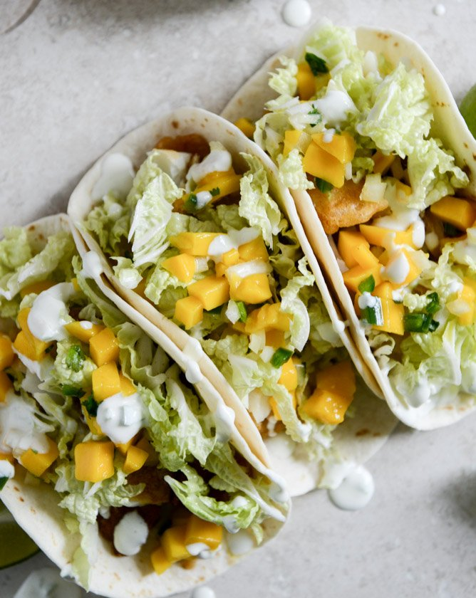 Beer battered fish tacos with mango margarita salsa and for Best fish tacos nyc