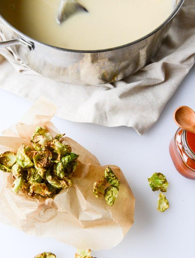 creamy roasted garlic potato soup with crispy brussels I howsweeteats.com