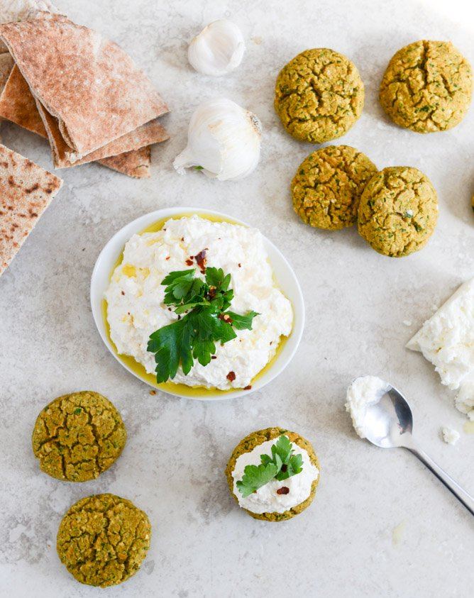baked falafel with spicy feta dip + 112 different lightened up meal ideas for the new year I howsweeteats.com