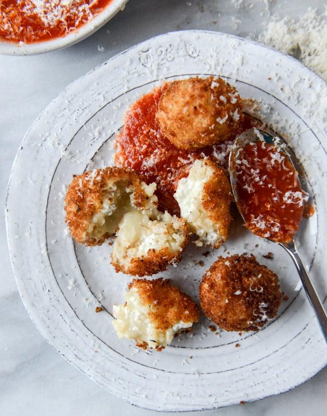 fontina, roasted garlic and goat cheese arancini I howsweeteats.com