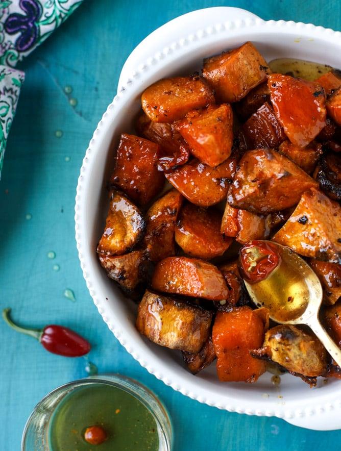 hot honey caramel sweet potatoes I howsweeteats.com #thanksgiving #sweetpotatoes #recipes
