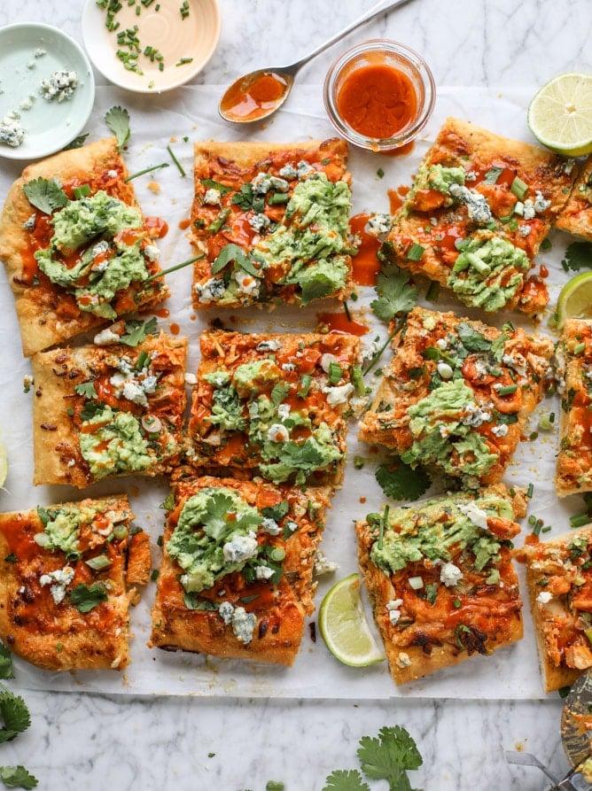 guacamole buffalo chicken pizza I howsweeteats.com #buffalochicken #pizza #guacamole #buffalowing