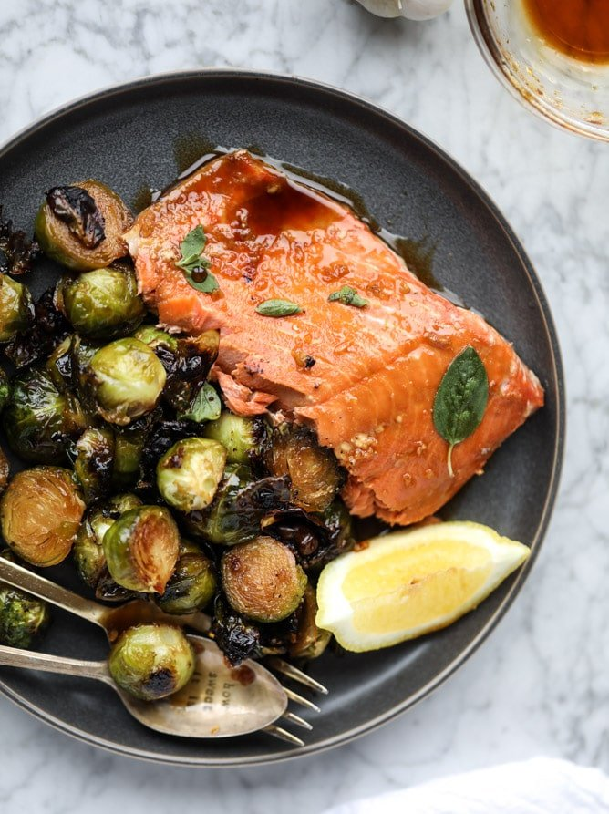 sheet pan honey garlic salmon and brussels I howsweeteats.com #sheetpan #salmon #honeygarlic #brusselssprouts