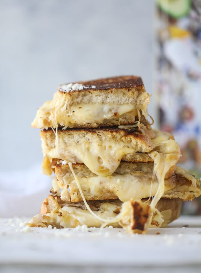 french onion grilled cheese with thyme butter I howsweeteats.com #grilledcheese #caramelizedonion #vegetarian