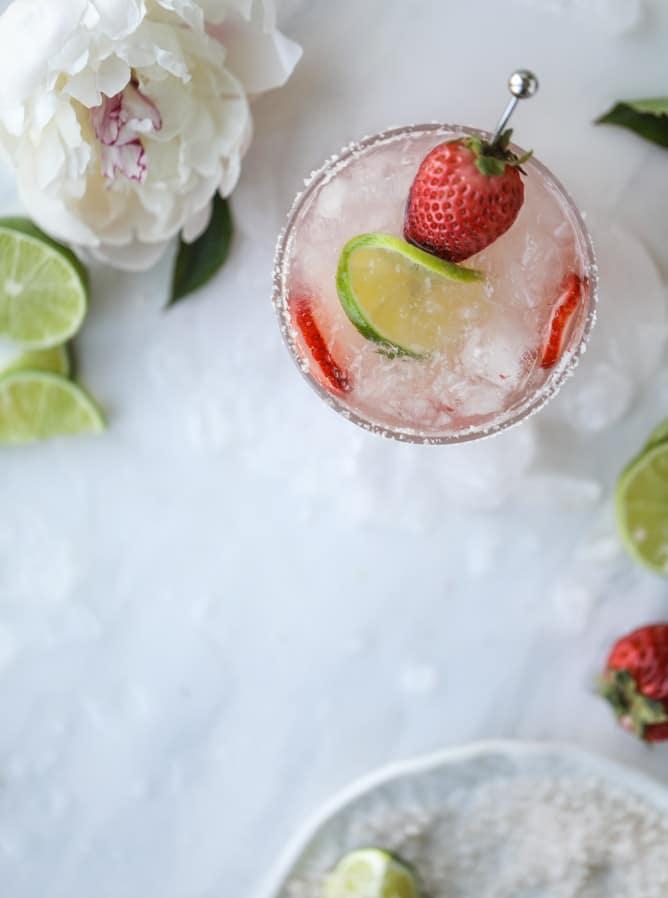 smoked strawberry mezcal margaritas I howsweeteats.com #margaritas #mezcal #strawberry #lime