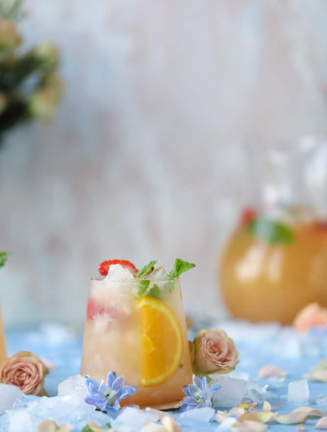 minted mimosa punch I howsweeteats.com #mimosa #punch #orangejuice #cocktails #champagne