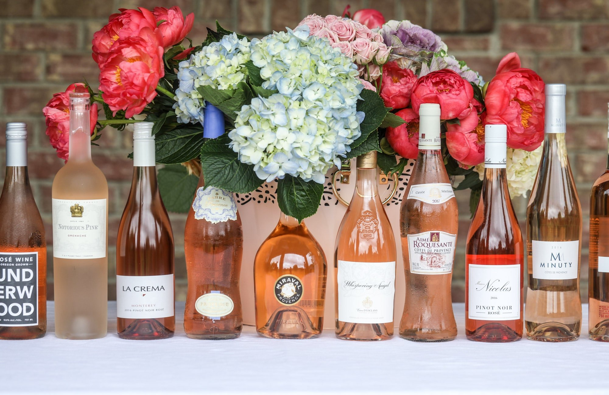 The best rosé to drink - all here in one epic summer guide for you! I'm sharing my personal favorite top ten rosé wines to drink in summer 2018, along with the perfect cheese board and snacks to go with. I howsweeteats.com #rosé #rose #summer #2018 #cheeseboard