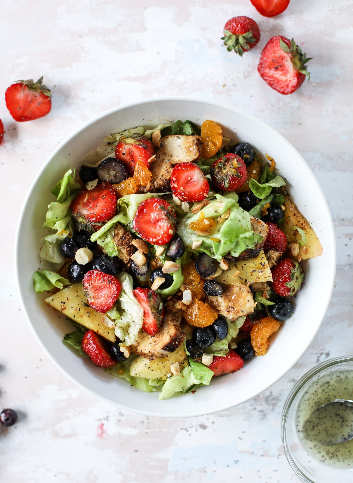 This copycat Panera strawberry poppyseed salad is absolutely delicious and refreshing and perfect for summer! Serve it with grilled chicken like the recipe here or swap for shrimp or fish. I howsweeteats.com #strawberry #poppyseed #salad #chicken #panera #copycat