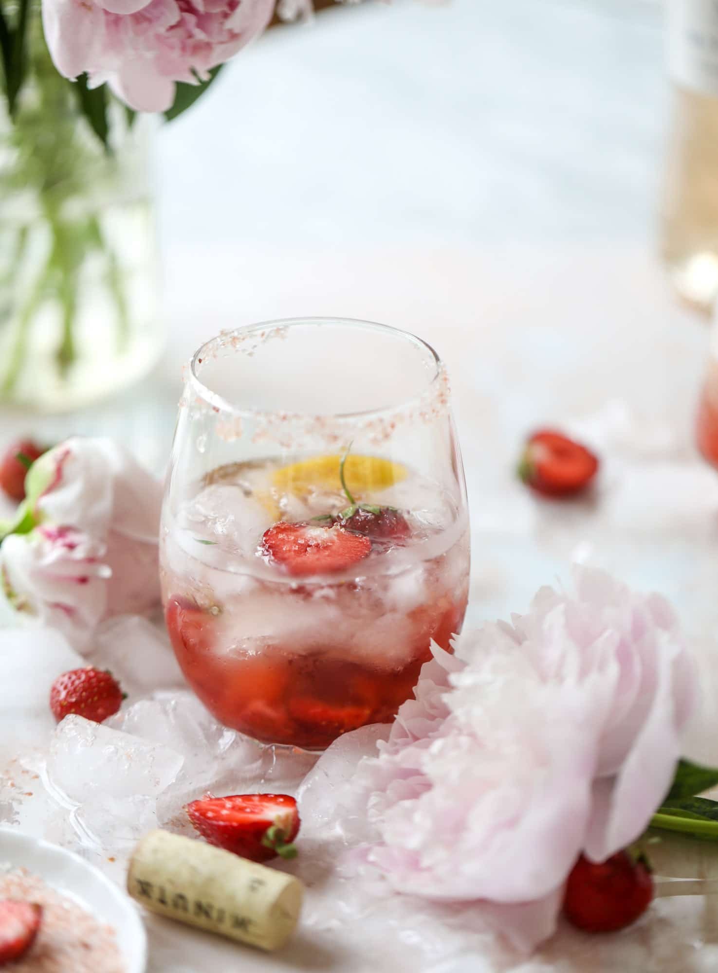 This tequila rosé spritz cocktail is perfectly refreshing for hot summer nights. A mix between a margarita and spritzer, this starts with muddled strawberries and honey, a shot of tequila and is topped off with your favorite rosé wine! I howsweeteats.com #tequila #rosé #wine #spritz #cocktail #strawberries