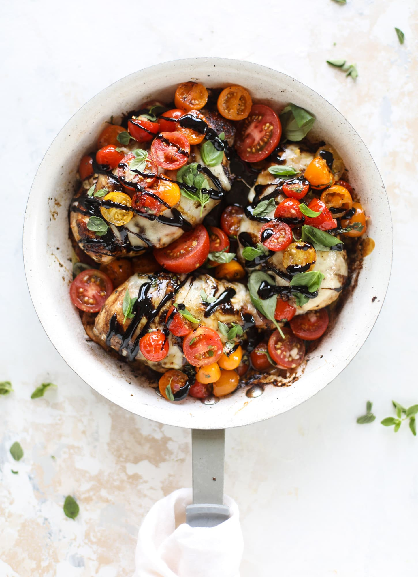 This bruschetta chicken is the perfect summer garden meal! Juicy, flavorful chicken topped with fresh tomatoes, garlic, basil and balsamic glaze, along with a touch of cheese. Served with pasta, it's an incredible meal. I howsweeteats.com #bruschetta #chicken #pasta #tomatoes #basil