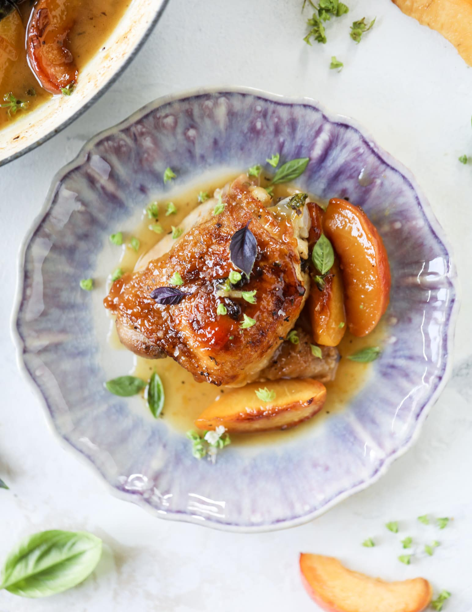 This amazing summertime one pot chicken is made with fresh peaches and basil and takes no time at all. The sweet and savory combination is perfect for a quick weeknight meal; the sauce is amazing for dipping and the chicken is flavorful as can be. I howsweeteats.com #chicken #peach #basil #easy #dinner #recipe #summer #healthy