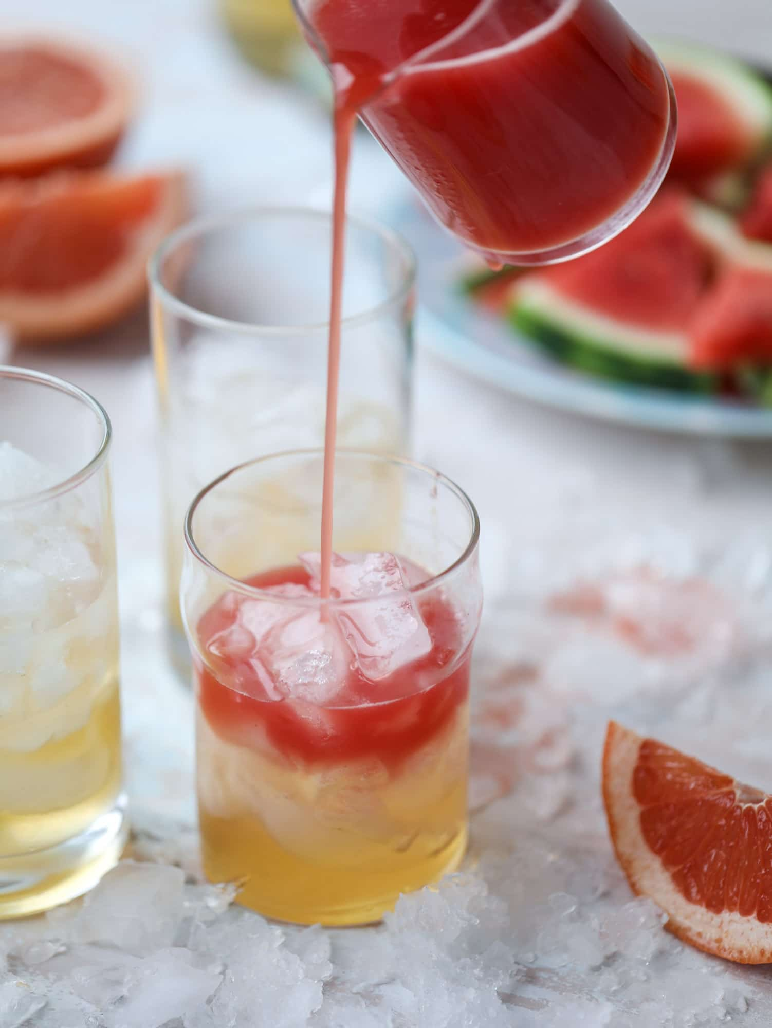 This watermelon grapefruit paloma cocktail is a summertime dream! Grapefruit syrup is super easy to make and when it's combined with fresh watermelon juice and tequila... oooh! Best happy hour ever. I howsweeteats.com #grapefruit #watermelon #paloma #cocktail #tequila