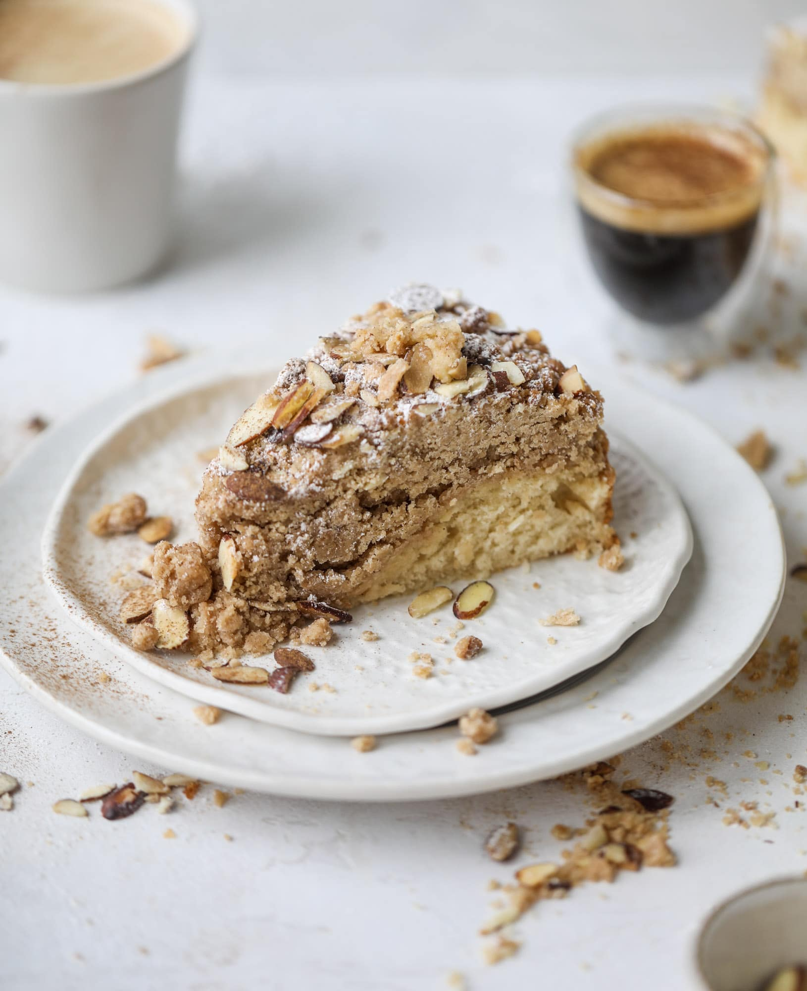 This almond crumb cake is so delicious and perfect for breakfast or dessert! It's full of delicious almond flavor and crunch and the crumb on top is so thick and perfect. It's like an almond croissant on steroids. I howsweeteats.com #almond #crumb #cake