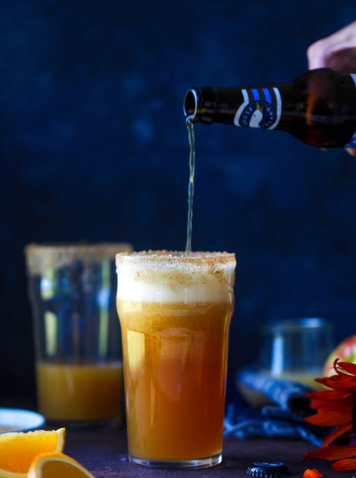 This apple cider shandy recipes is perfect for the fall season! Apple cider, sparkling cider and your favorite beer come together in an icy glass to create the best flavor ever. Finished with a cinnamon sugar rim, there's nothing better! I howsweeteats.com #apple #cider #shandy #cocktails #beer