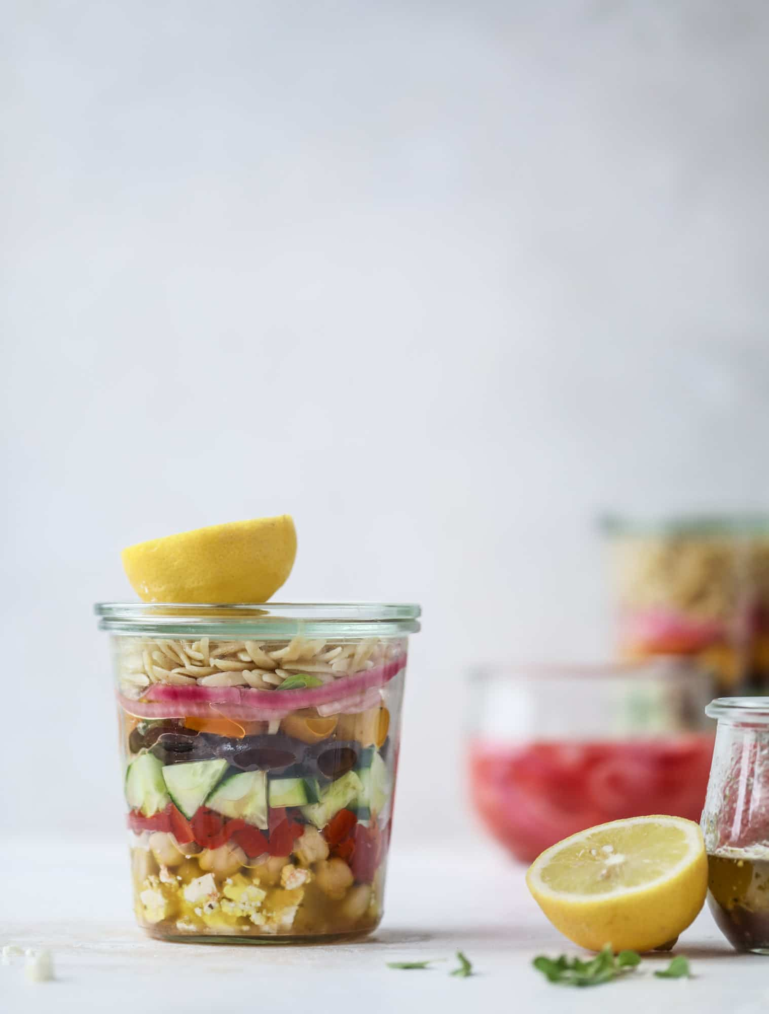 This incredible greek orzo salad in a jar is to die for! The recipe is so easy and flavorful, super satisfying and perfect for meal prep. This salad in a jar is a delicious lunch idea for the weekdays and keeps you feeling full and happy! I howsweeteats.com #salad #jar #greek #orzo #recipes #healthy #lunch #mealprep