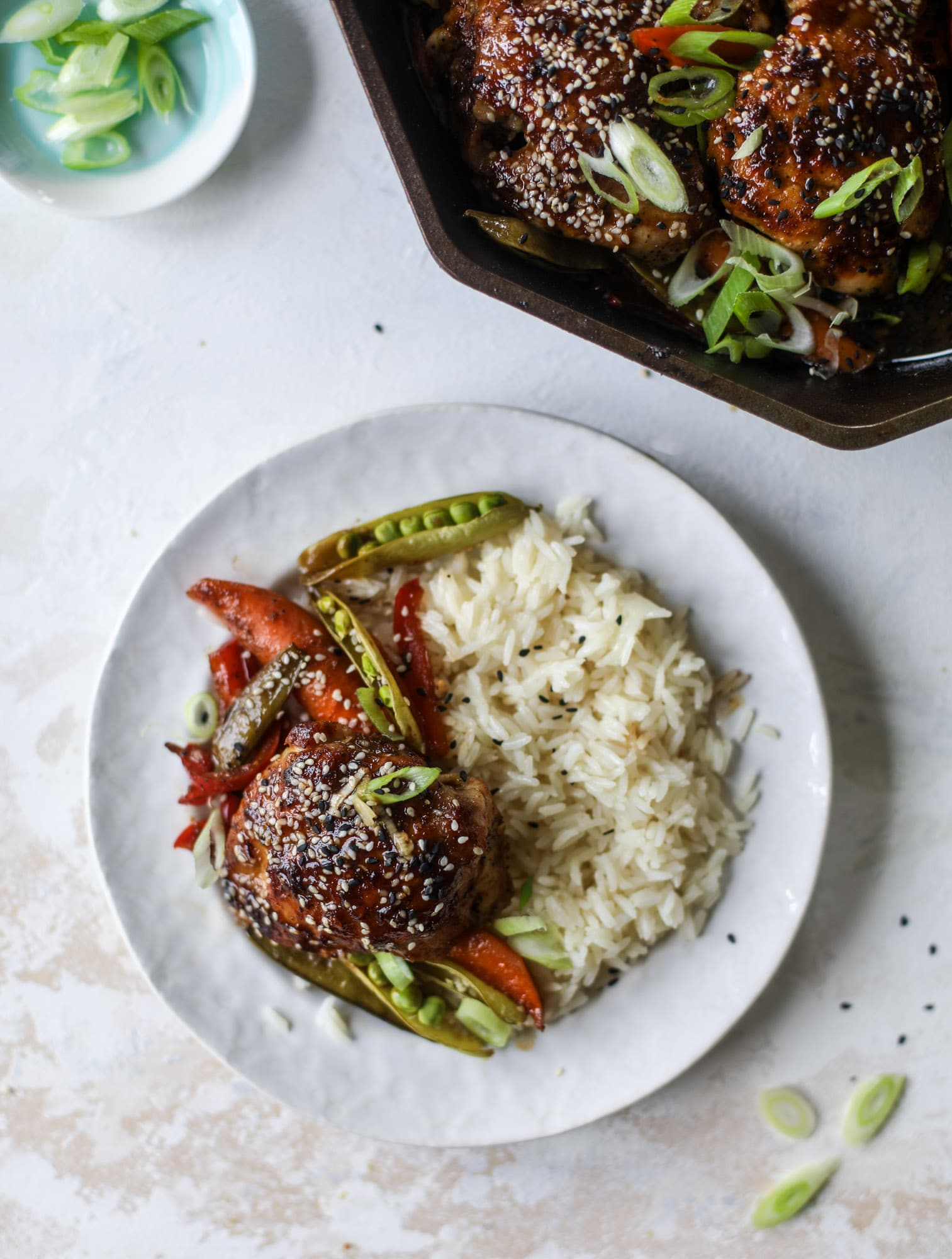 This one pan sesame chicken and veggies is so easy and delicious! It's the perfect weeknight meal that is packed with flavor. The chicken and veggies are great on their own but also wonderful when paired with brown rice or quinoa! I howsweeteats.com #one #pan #sesame #chicken #dinner #easy