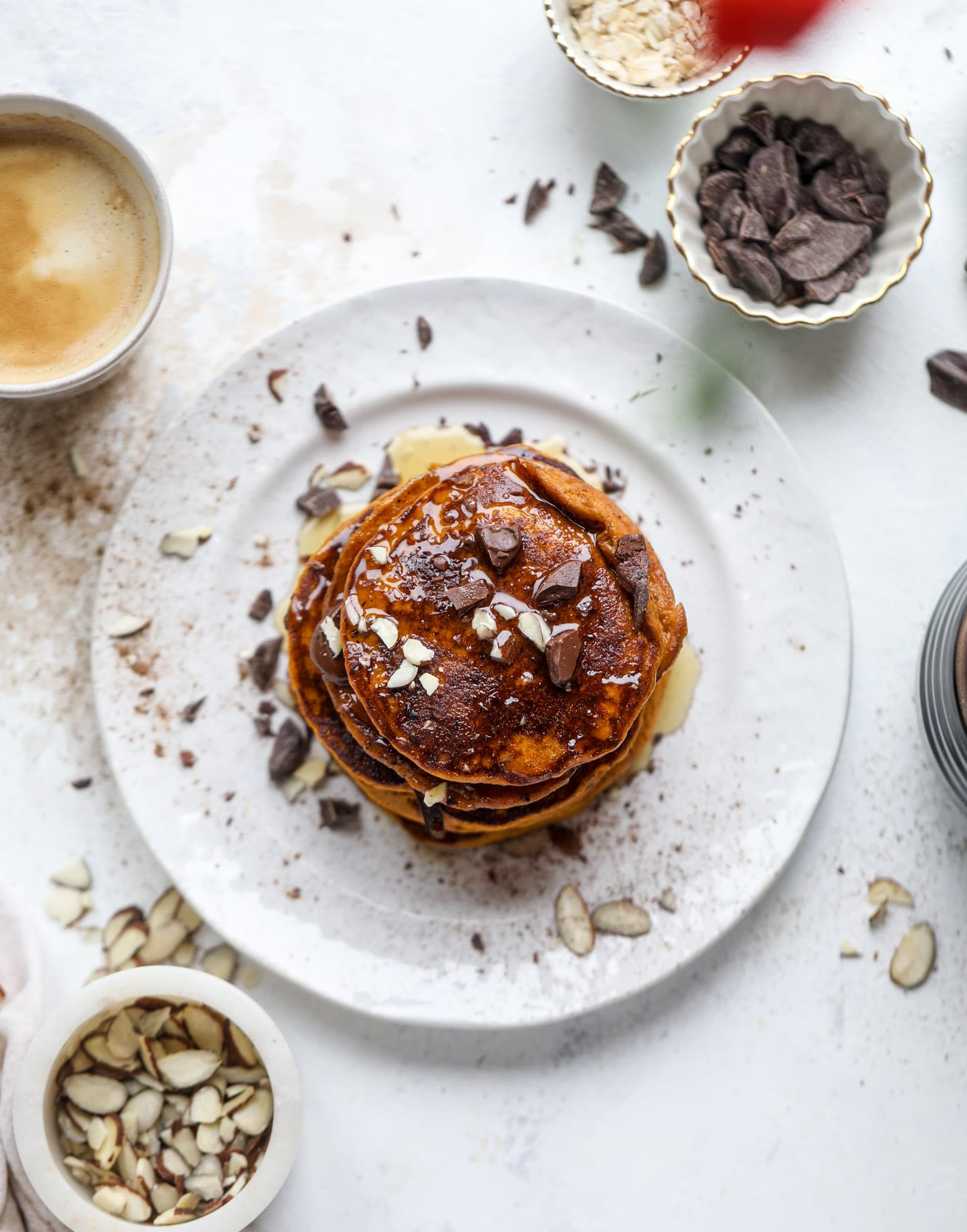 These pumpkin protein pancakes are packed with delicious ingredients to make a healthy and satisfying fall breakfast! They are super easy - you throw everything into a blender to create the most incredible protein pancakes! I howsweeteats.com #protein #pancakes #pumpkin #breakfast #fall
