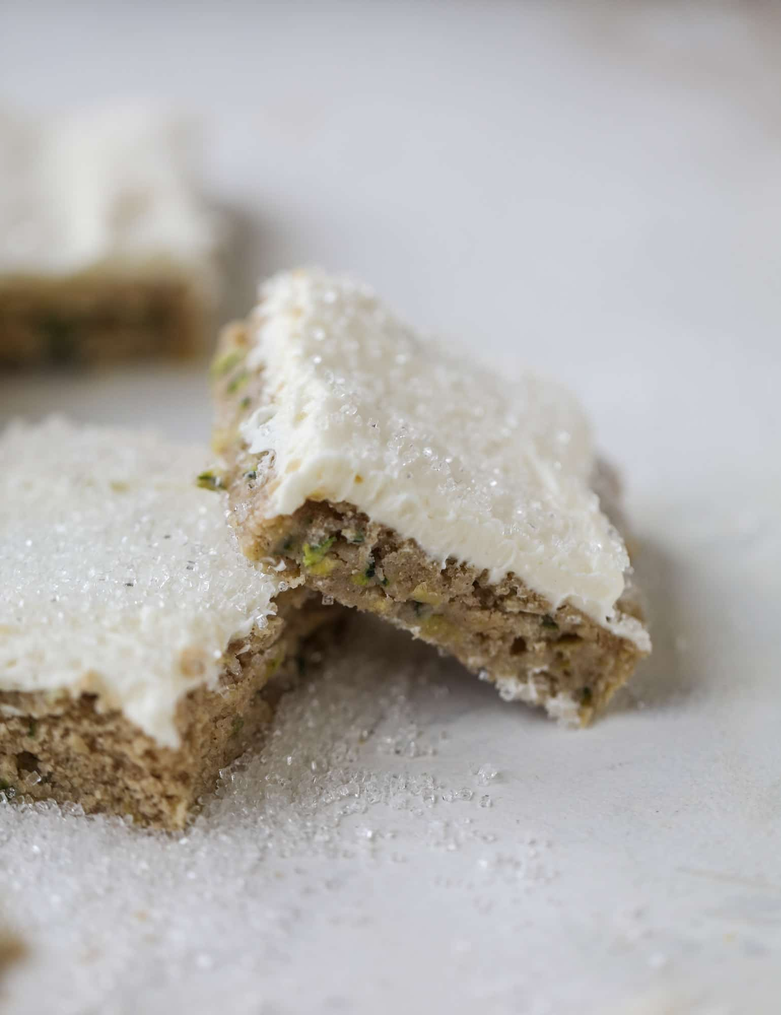 These zucchini bars with cream cheese icing are a fun twist on zucchini bread! Zucchini bars are super easy to make, have a little spice and a lot of flavor, topped with the creamiest cream cheese frosting. Delicious and simple! I howsweeteats.com #zucchini #bars #cream #cheese #icing #dessert