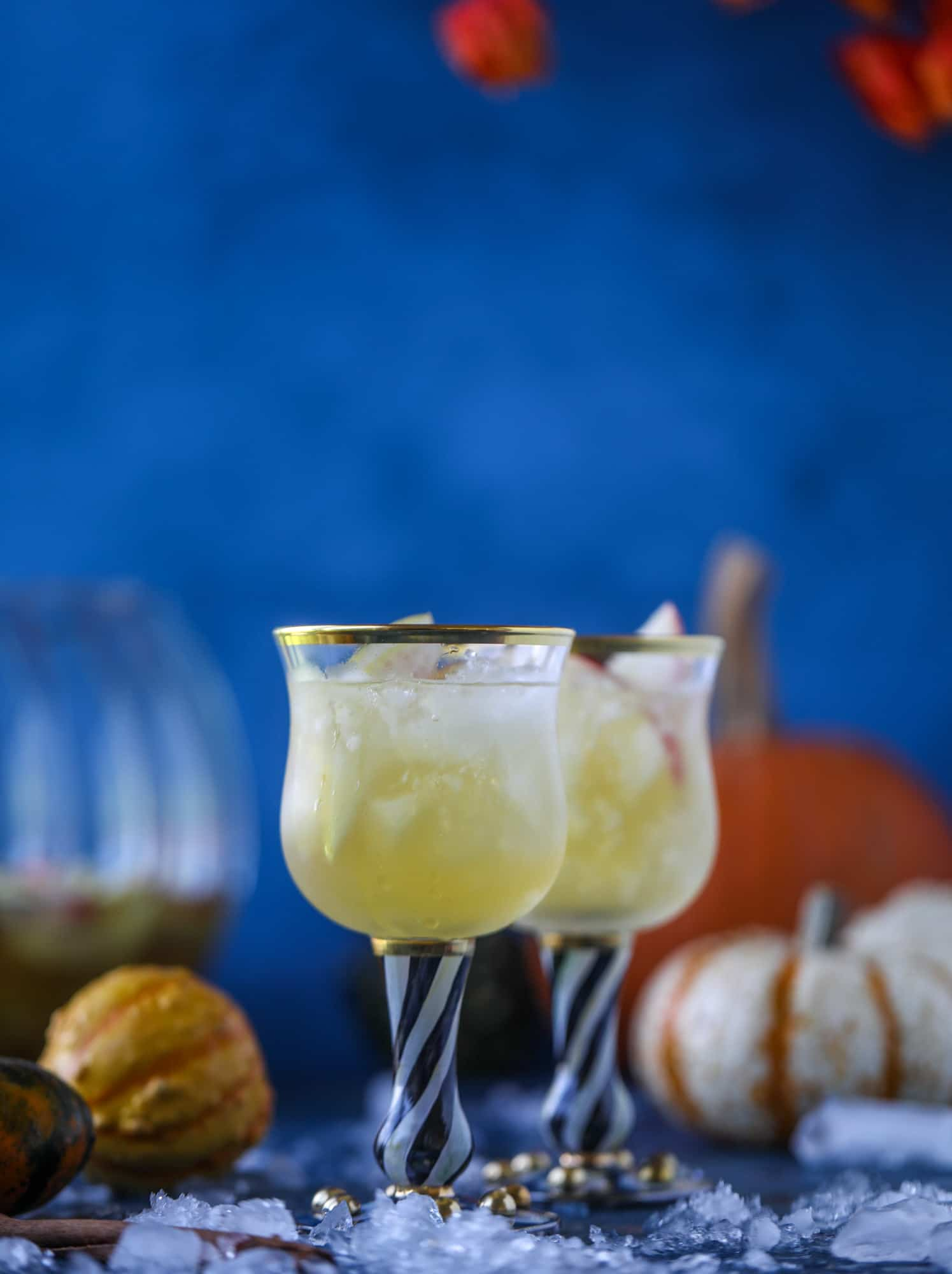 This pumpkin sangria is perfect for the fall and holiday season! A homemade pumpkin pie syrup gives the drink excellent flavor along with bubbles and apple cider and of course, boozy fruit. It's a favorite for Halloween or Thanksgiving! I howsweeteats.com #pumpkin #sangria