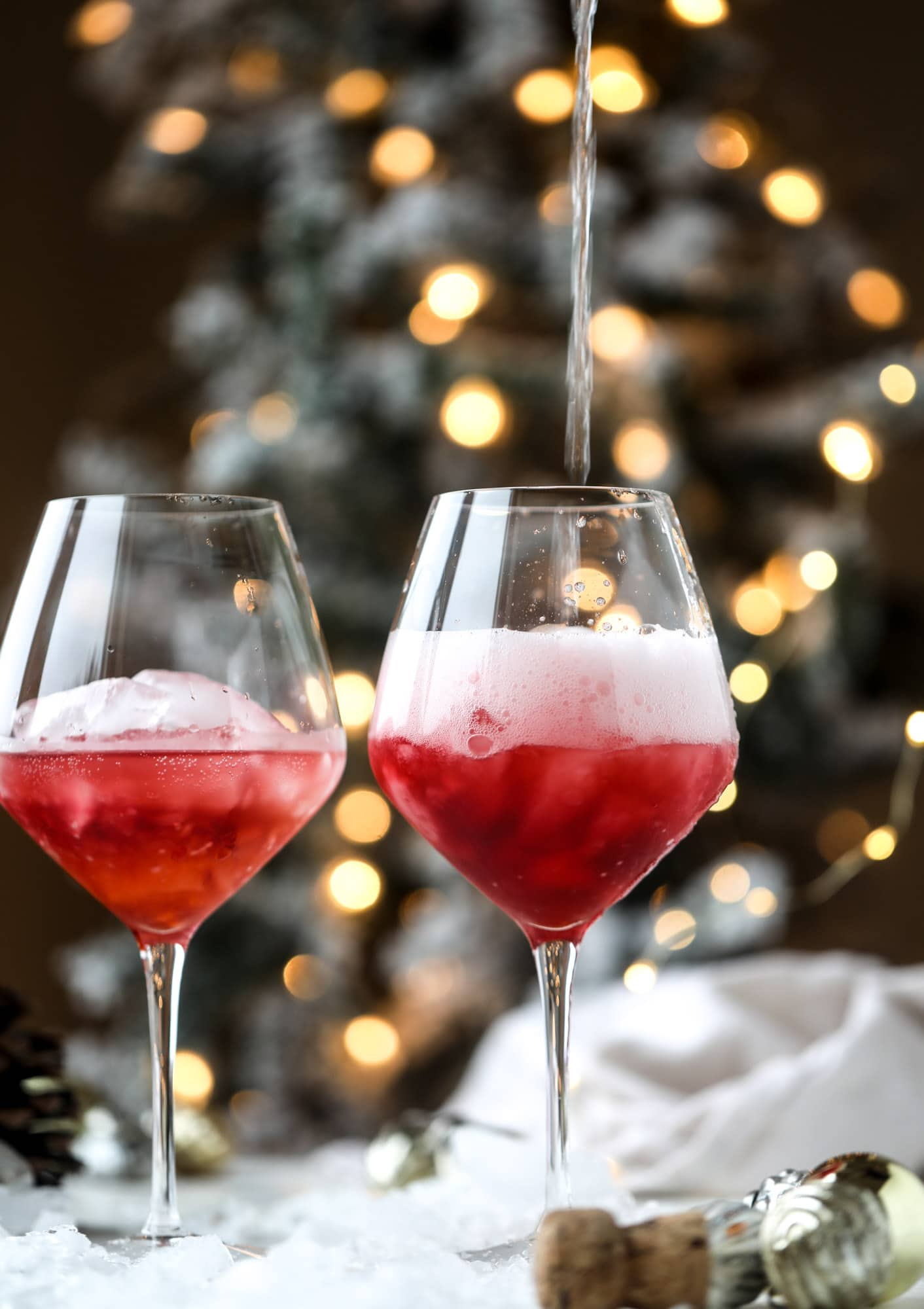 This winter aperol spritz cocktail is a seasonal spin on the classic aperol spritz! Festive cranberry and classic orange come together with prosecco and club soda to create a super light and refreshing cocktail for the holidays! I howsweeteats.com #aperol #spritz