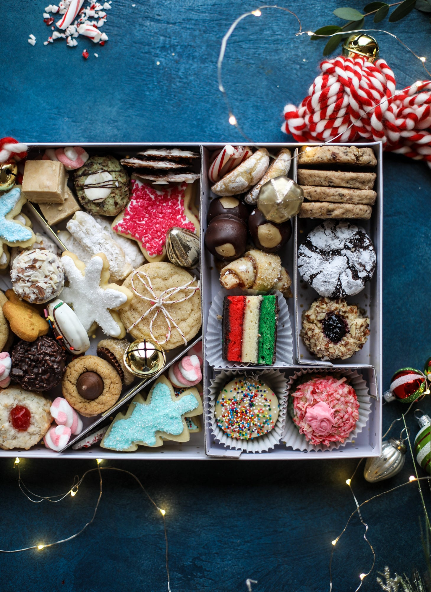 This list is made up of my 2018 best cookies to bake for Christmas and the holiday season! These are tried and true favorites that our friends and family love - ones we put on our cookie trays every single year! I howsweeteats.com #cookies #christmas #box