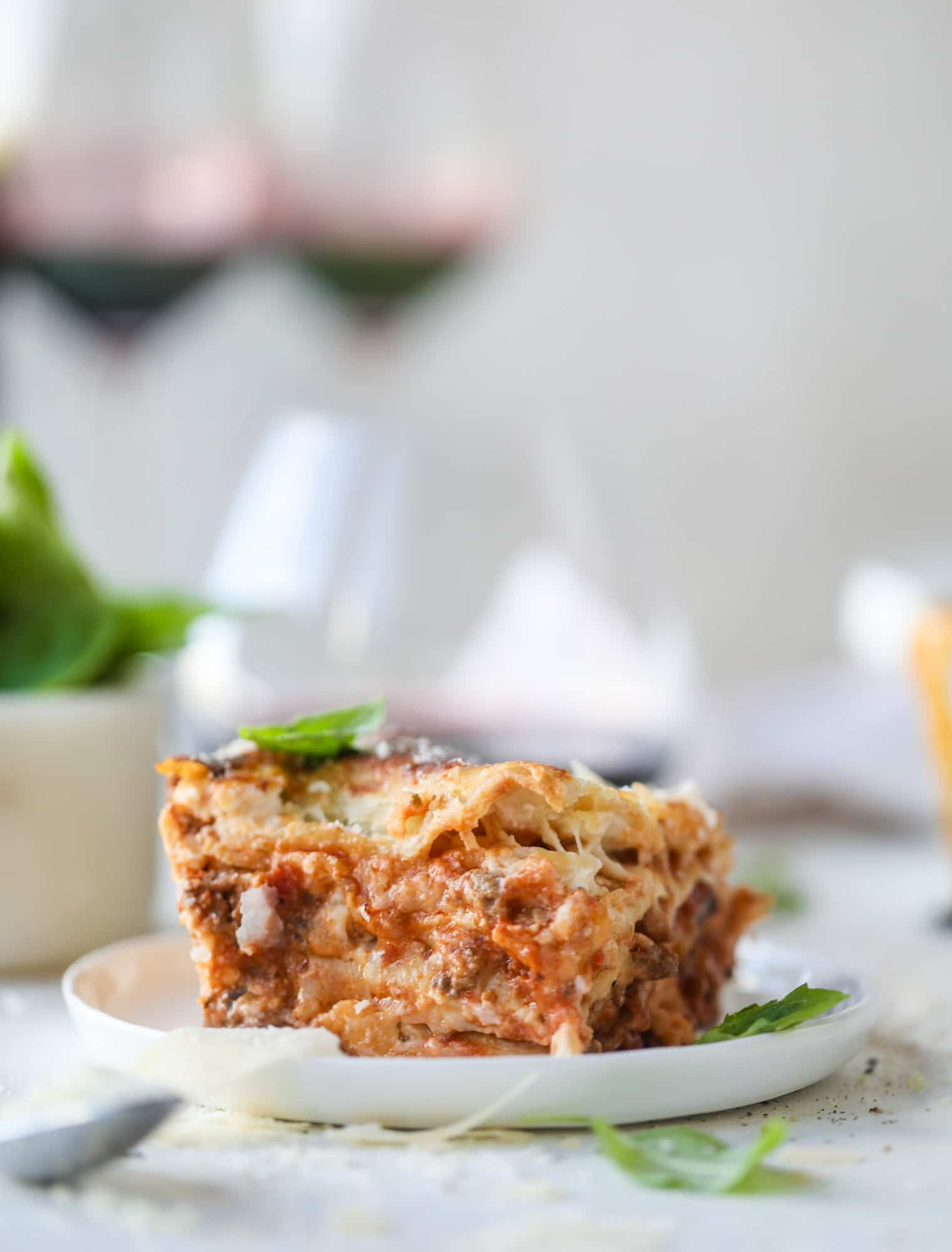 This lasagna bolognese is the ultimate comfort food. Meaty sauce, whole wheat lasagna noodles, creamy bechamel and grated cheese come together to create the most perfect slice of lasagna heaven! I howsweeteats.com #lasagna #bolognese