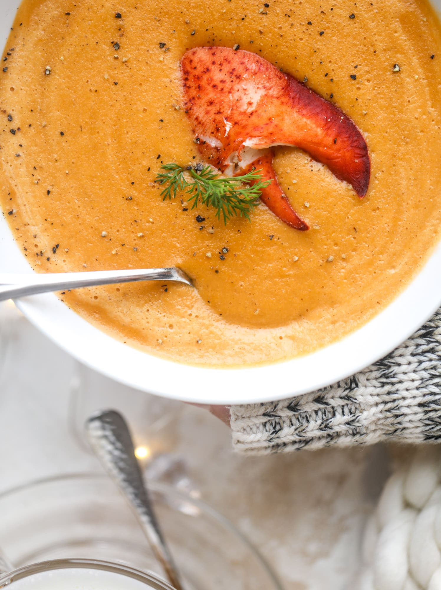 This lobster bisque recipe is delicious, easy and always a crowd pleaser! It's so simple to make at home and it's a rich, decadent treat to serve your family. I also show you how to make a lobster cappuccino, which is lobster bisque with foamed cream! I howsweeteats.com #lobster #bisque