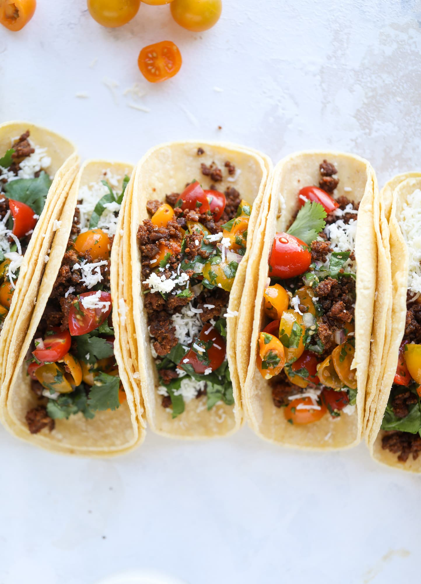 Weeknight ground beef tacos that are anything like the 90s! These are made with a homemade taco seasoning and served with the perfect toppings! I howsweeteats.com #groundbeef #tacos