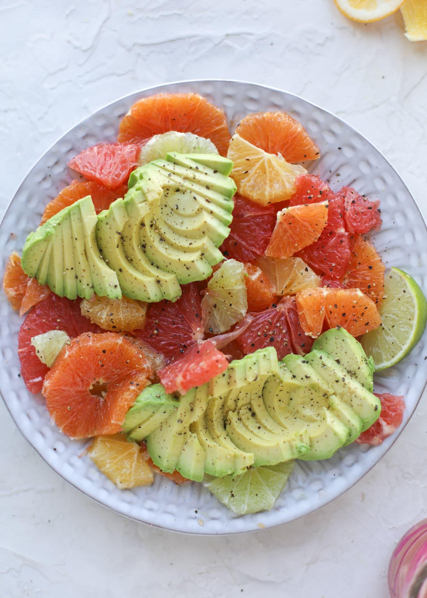A deliciously fresh and invigorating avocado citrus salad with honey lime vinaigrette. It's creamy, tart, sweet and refreshing! I howsweeteats.com #avocado #citrussalad