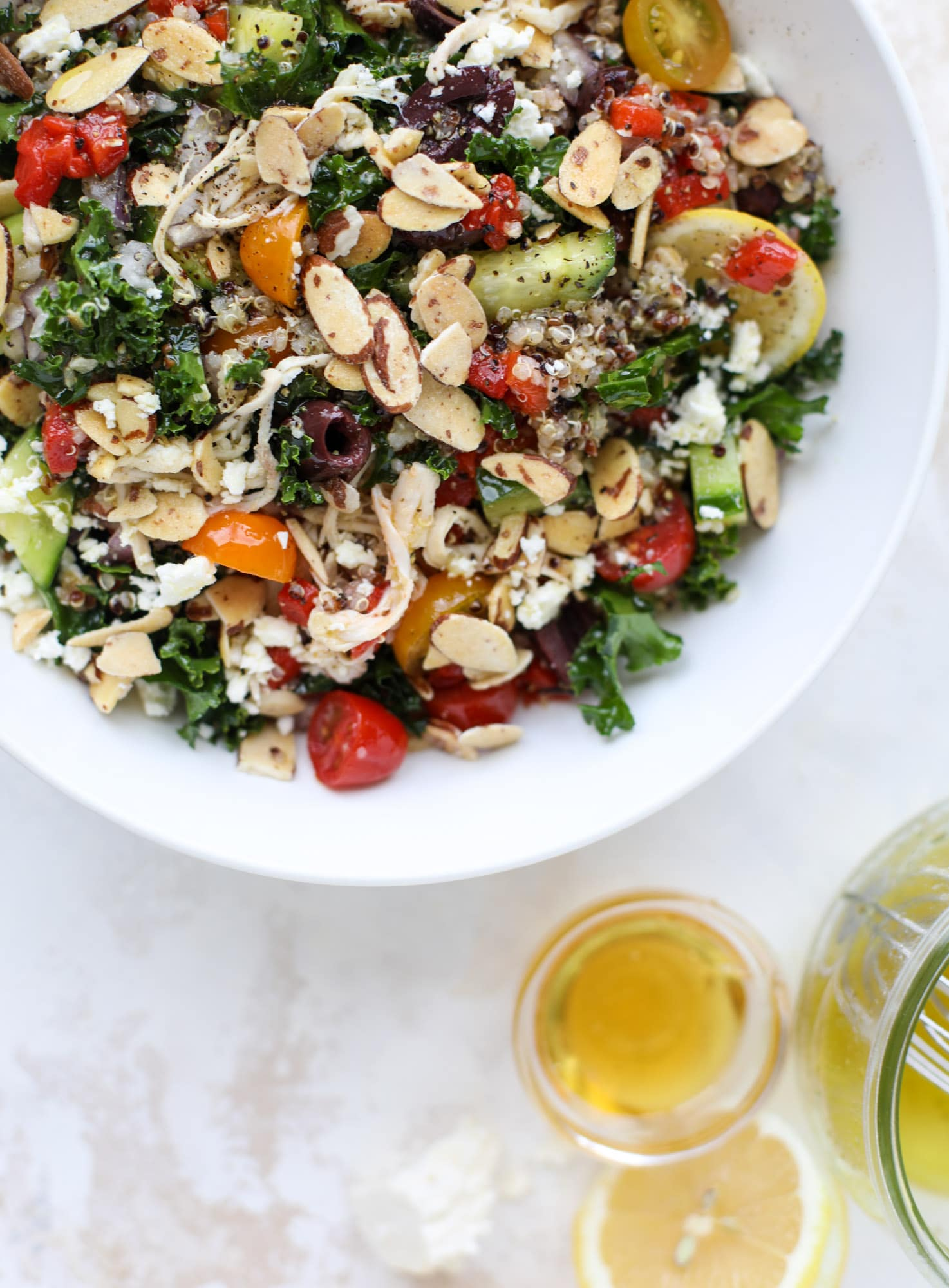 This mediterranean kale and quinoa salad is a copycat for the delicious Panera Bread Modern Greek Salad with Chicken. Super easy and satisfying! I howsweeteats.com #mediterranean #kalesalad