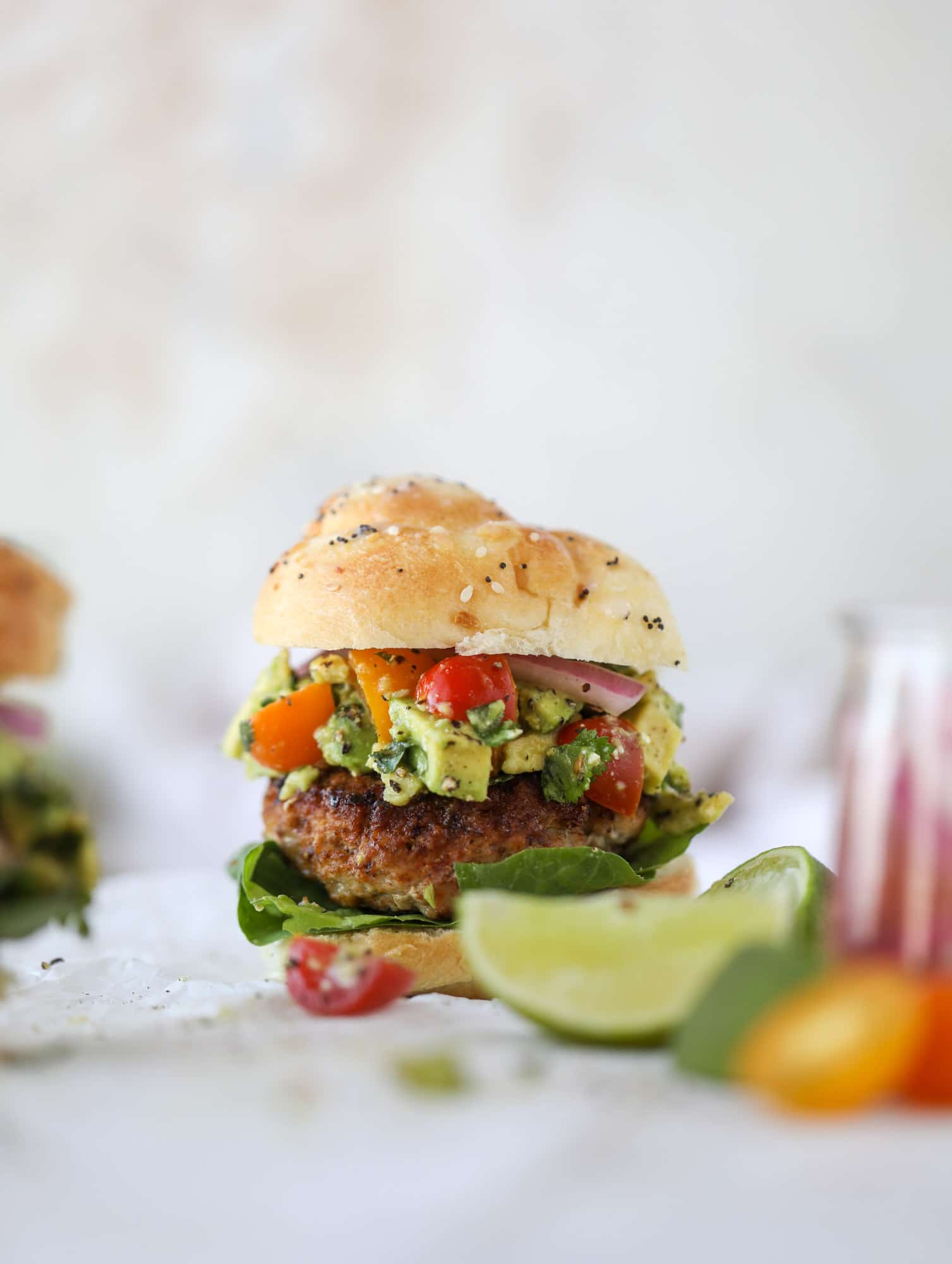 These turkey burgers are full of flavor and topped with a delicious chunky guacamole to take the flavor over the top. The perfect easy dinner! I howsweeteats.com #turkey #burgers