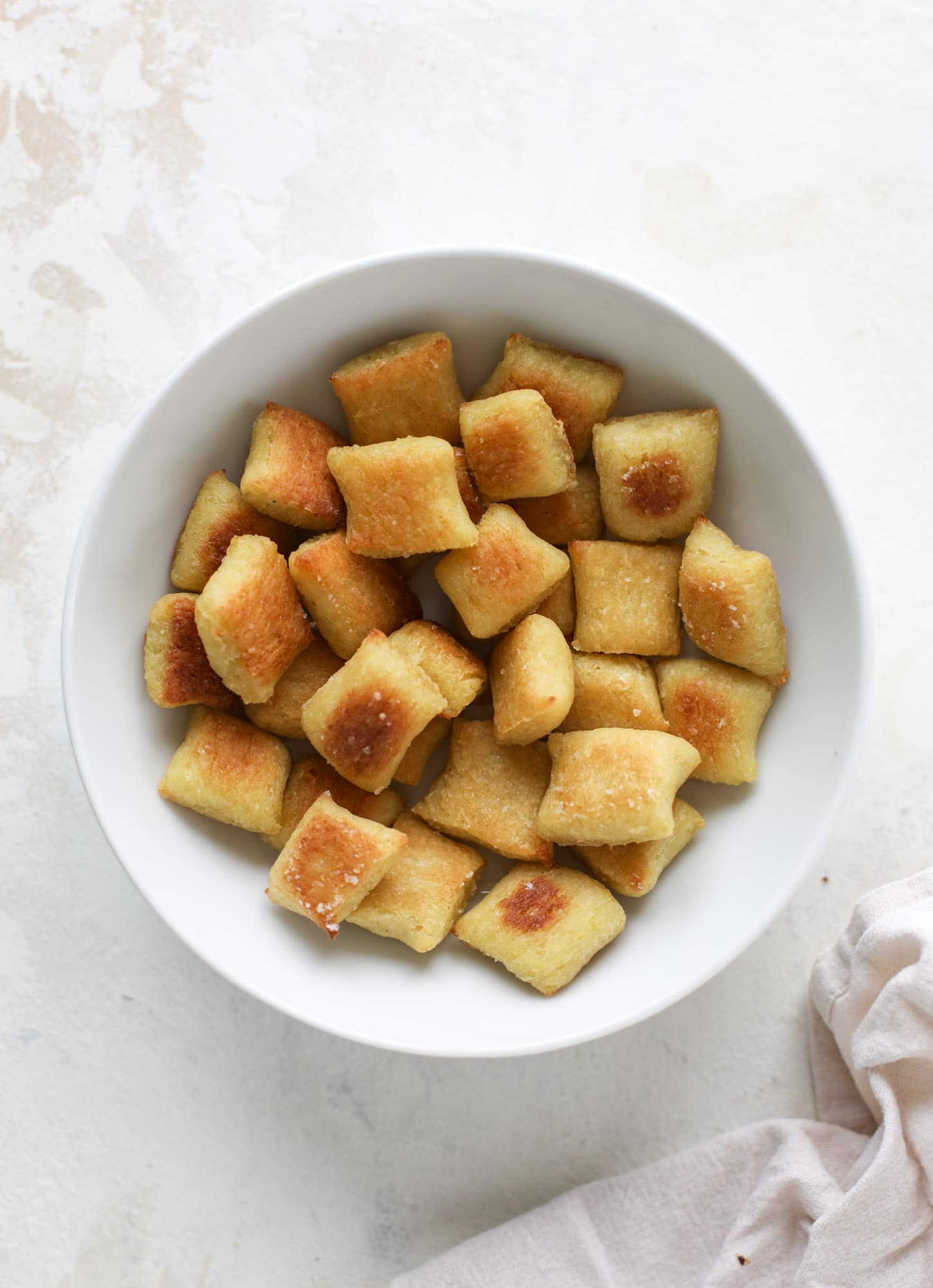 Homemade cauliflower gnocchi that tastes just like the Trader Joe's version! It's made with cauliflower, comes together fast and is super easy! I howsweeteats.com #cauliflower #gnocchi