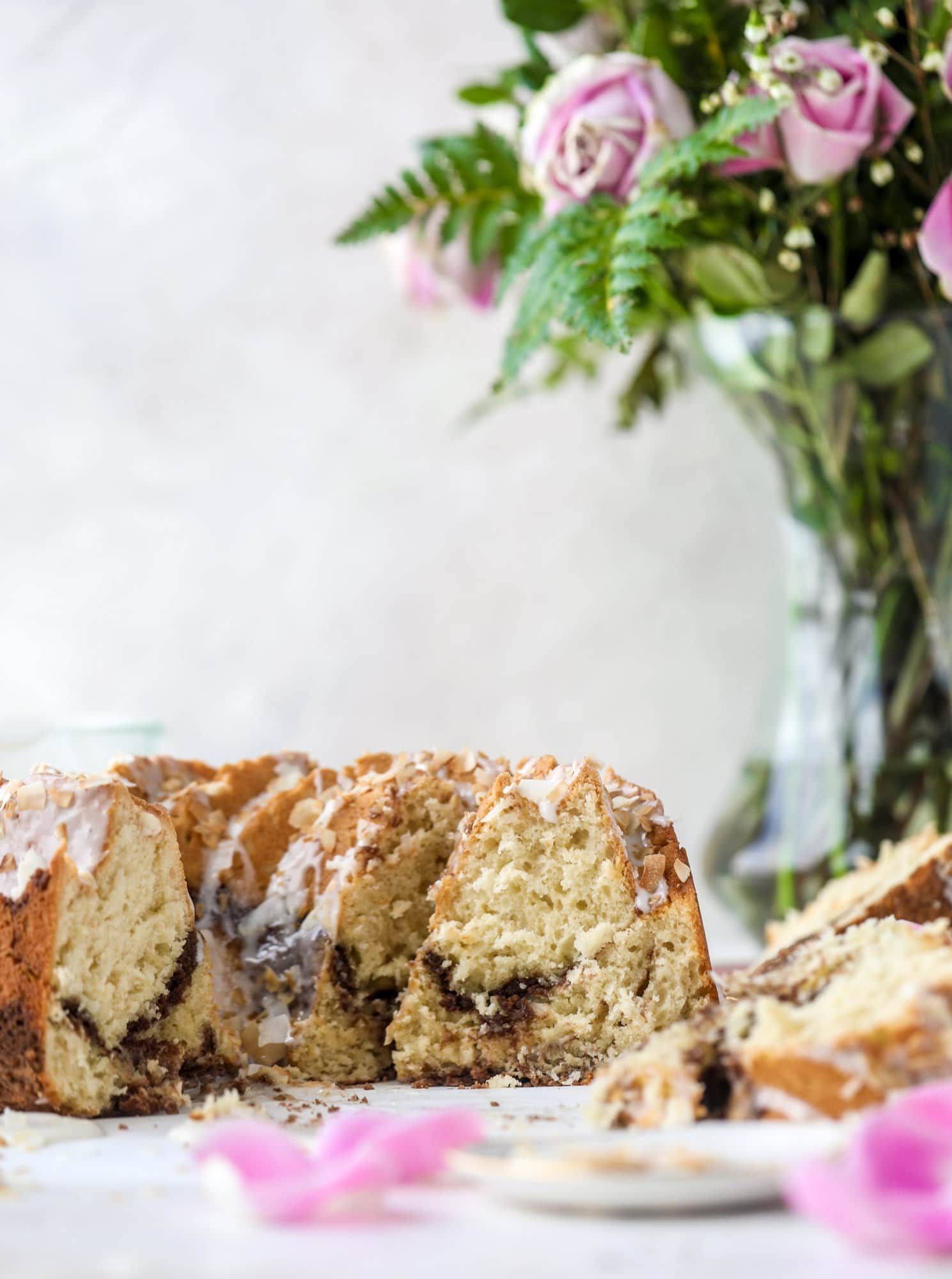 Make breakfast and brunch better with coconut coffee cake! Tender coconut cake with a cocoa sugar streusel and a coconut glaze. To die for!
