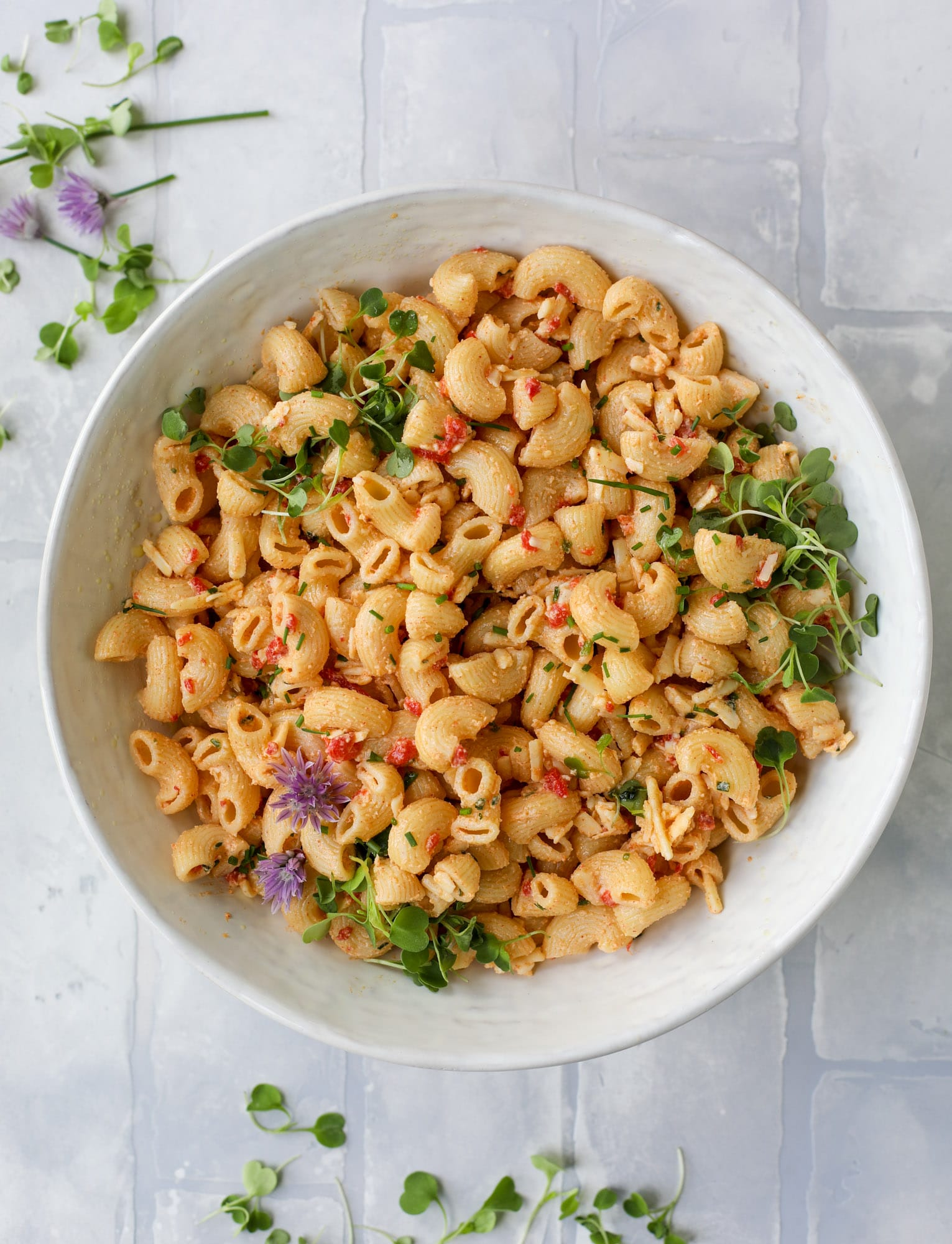 This pimento cheese pasta salad is the perfect summer side dish! All the flavor of pimento cheese and all the comforts of pasta salad, in one bowl!