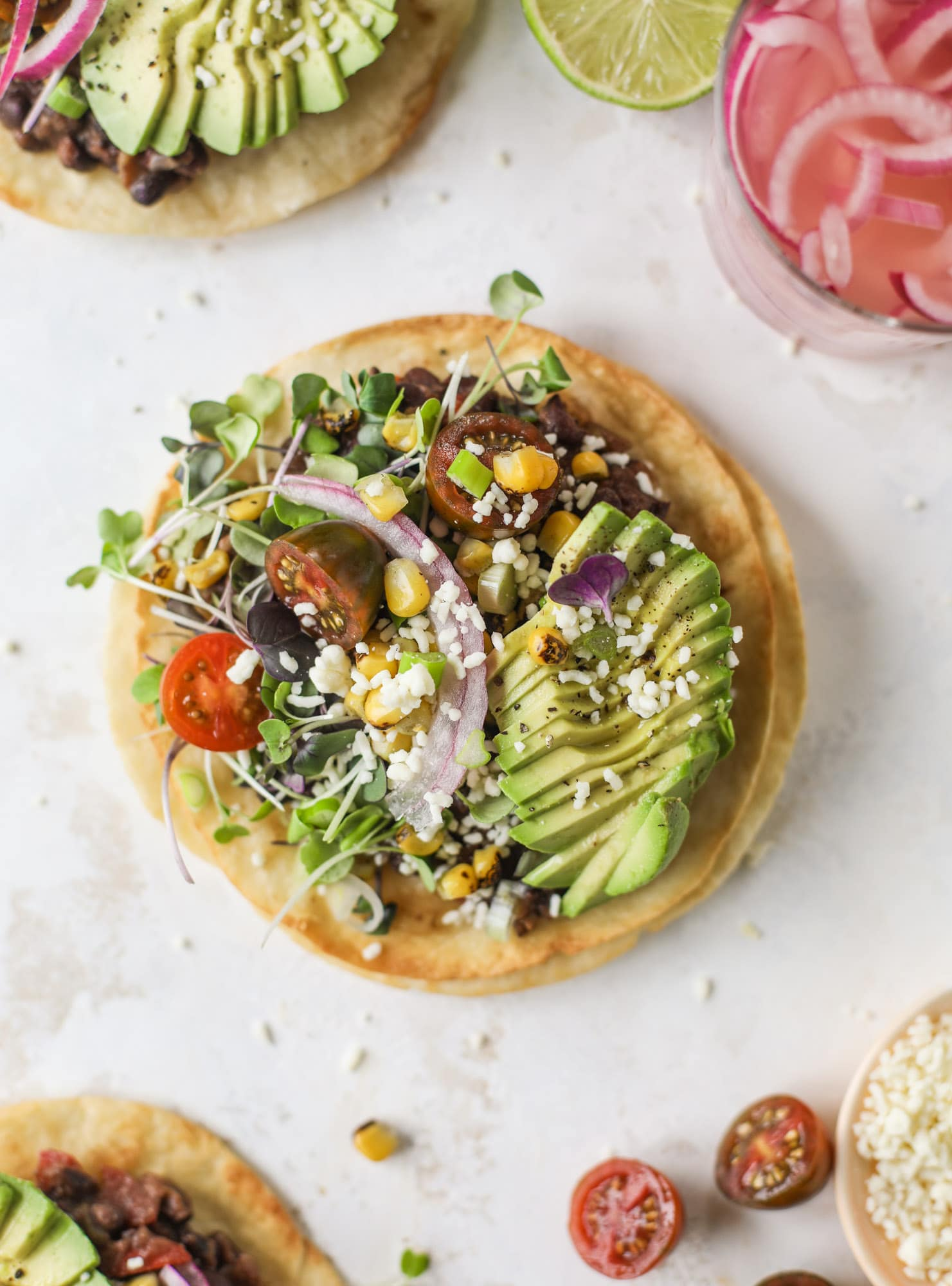 These saucy black bean tostadas are super flavorful and easy for a weeknight meal. Crunchy tortillas topped with beans and tons of veggies. Delish!