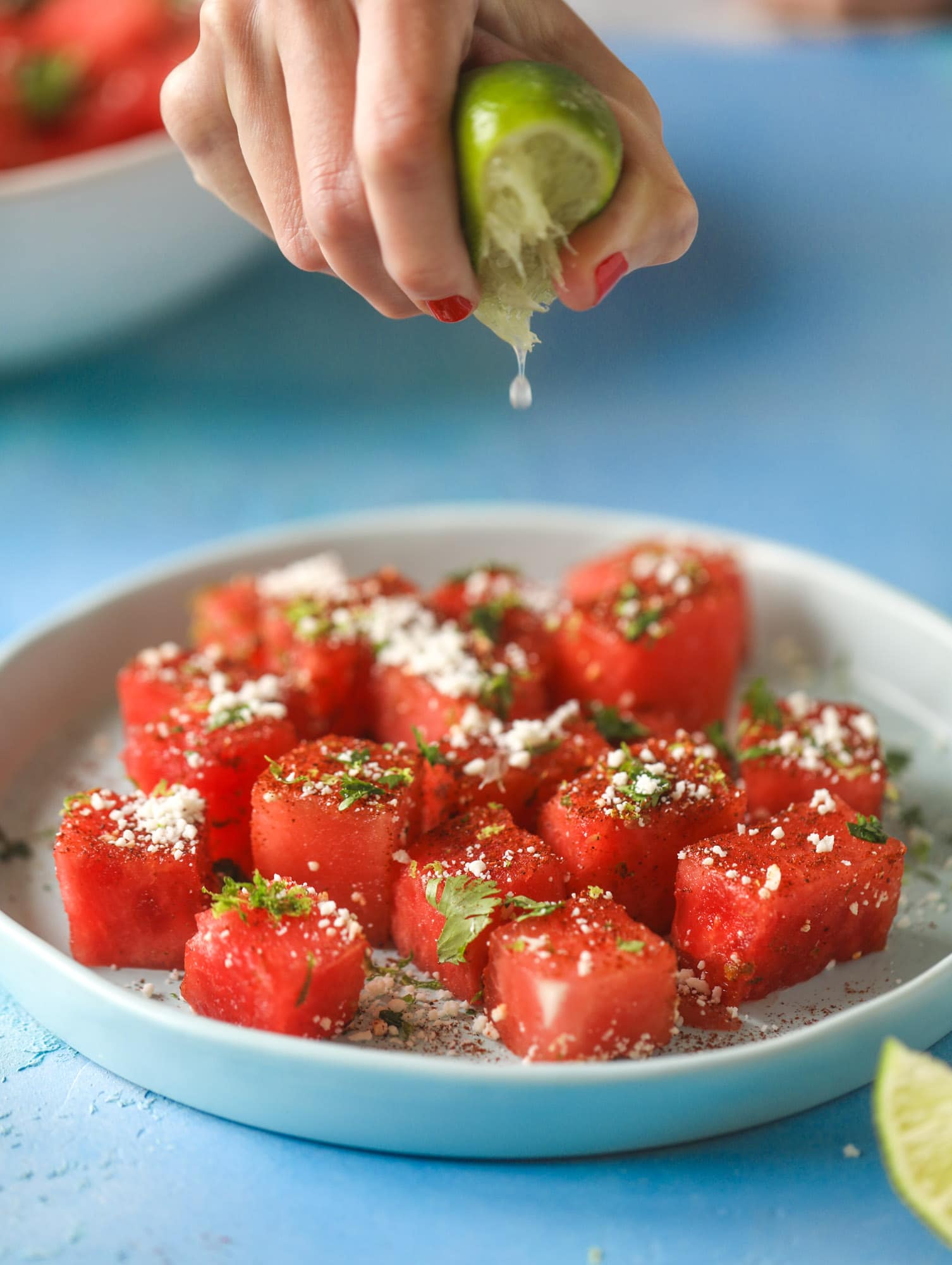 This chili lime watermelon is the perfect summer snack! It's savory and sweet with crumbled cotija cheese and lots of lime. Delish!