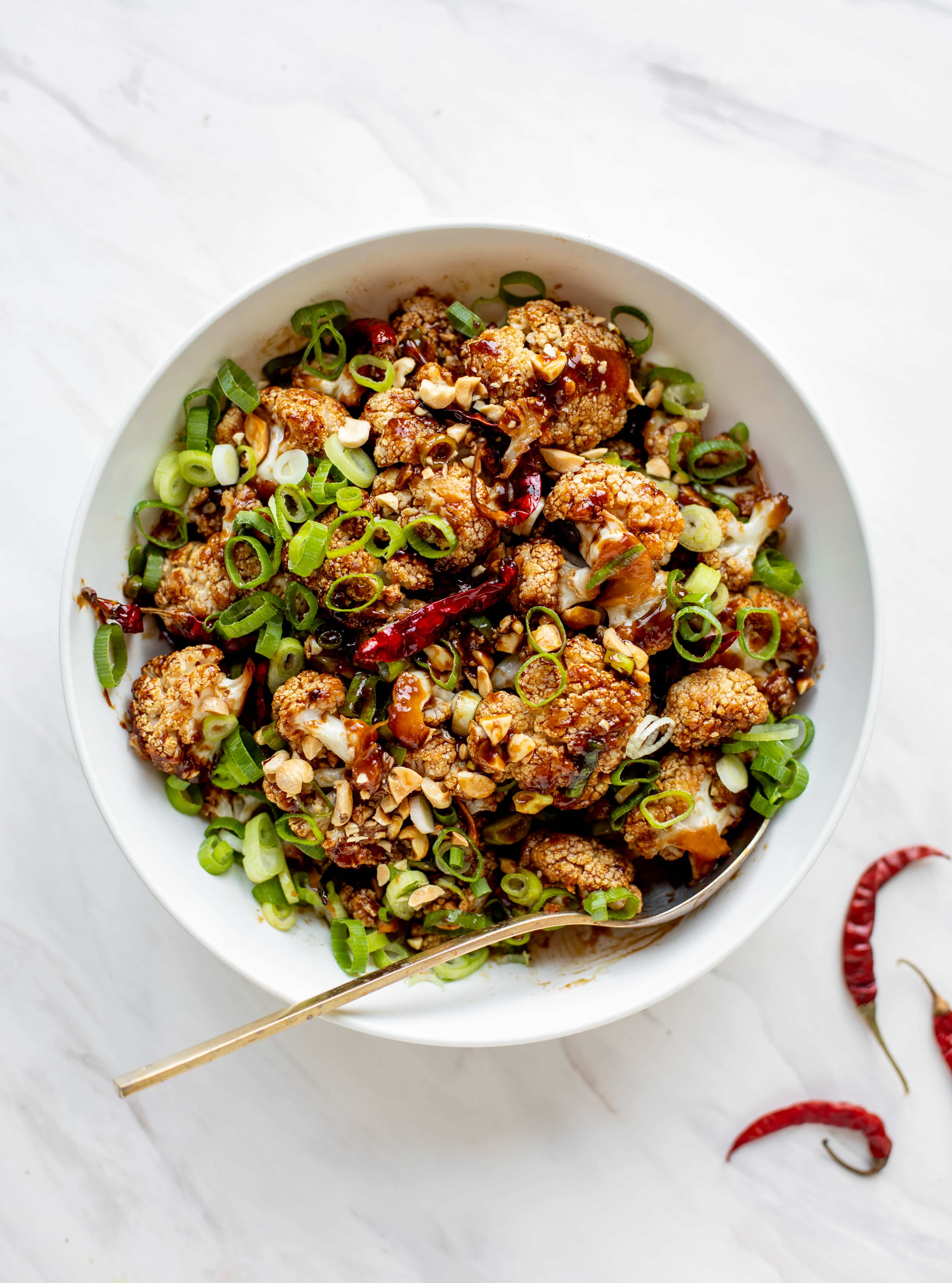 This kung pao cauliflower recipe is roasted on one sheet pan and covered in a delicious sauce! Serve alongside jasmine rice for the best dinner ever.