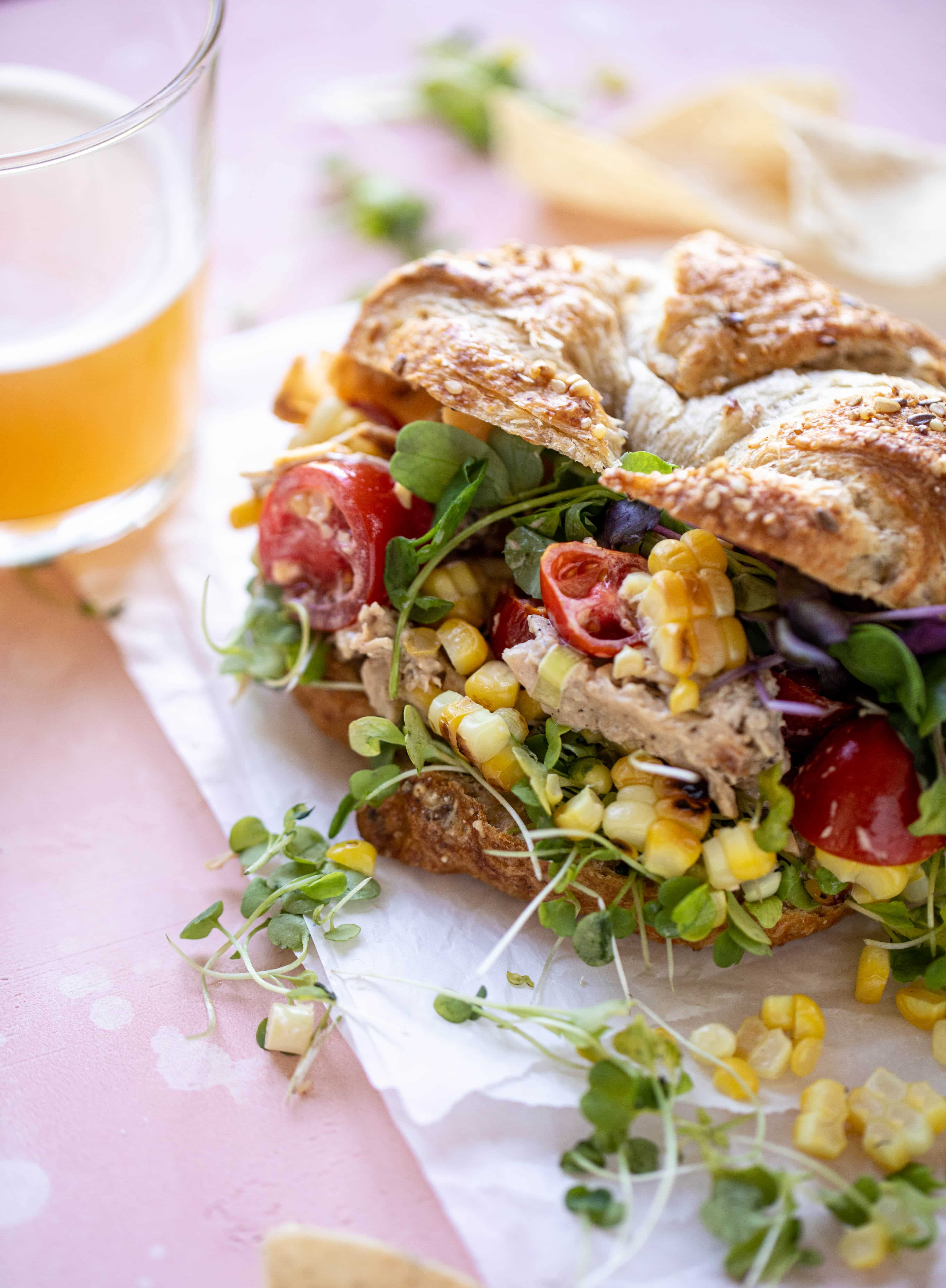 This smoky summer chicken salad is incredible! So much flavor from grilled chicken, sweet cherry tomatoes, corn, cheddar cheese and a secret ingredient!