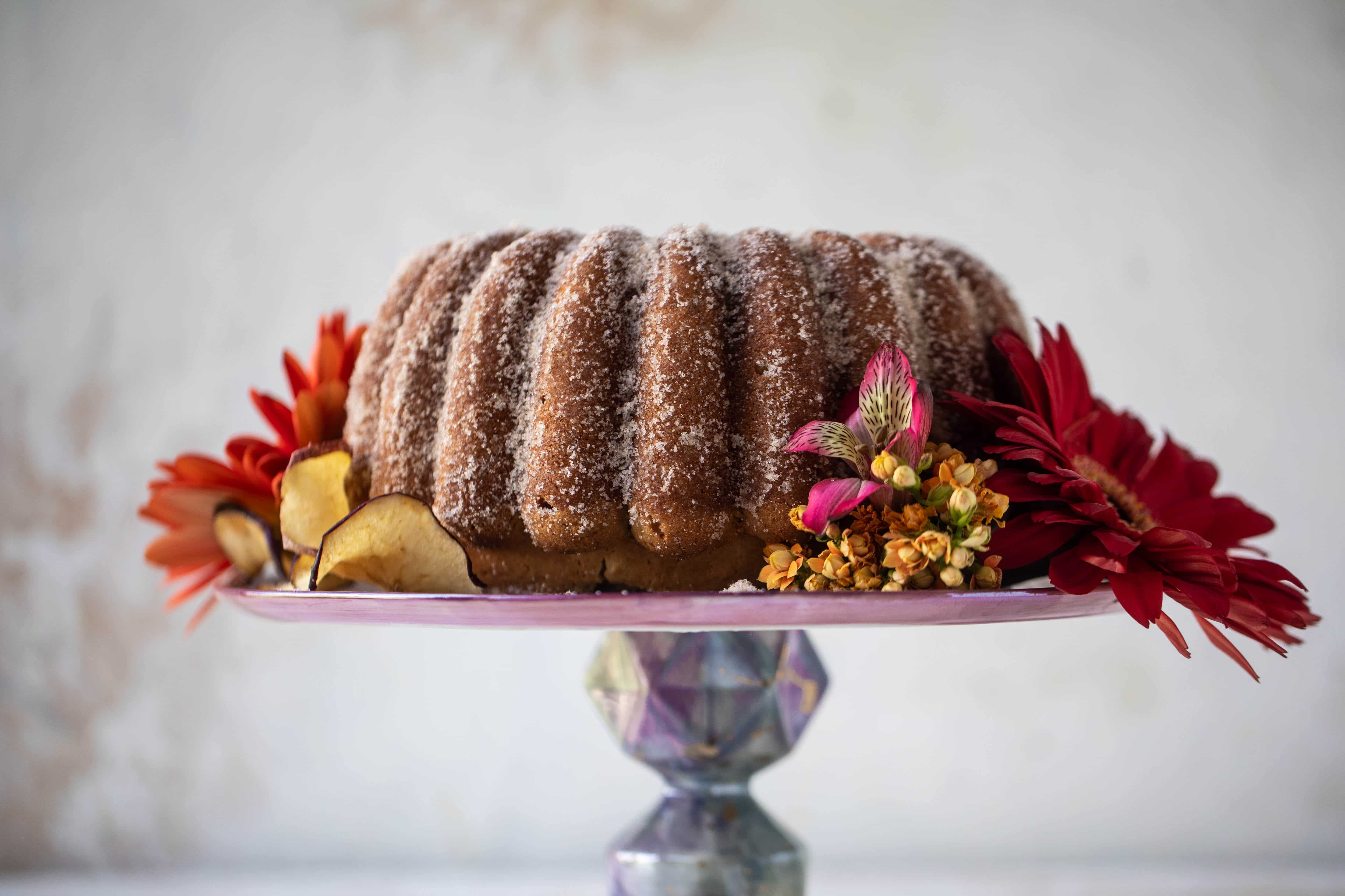 This apple cider donut cake is a huge fall crowd pleaser! Covered in cinnamon sugar and fluffy to perfection. It's incredible!
