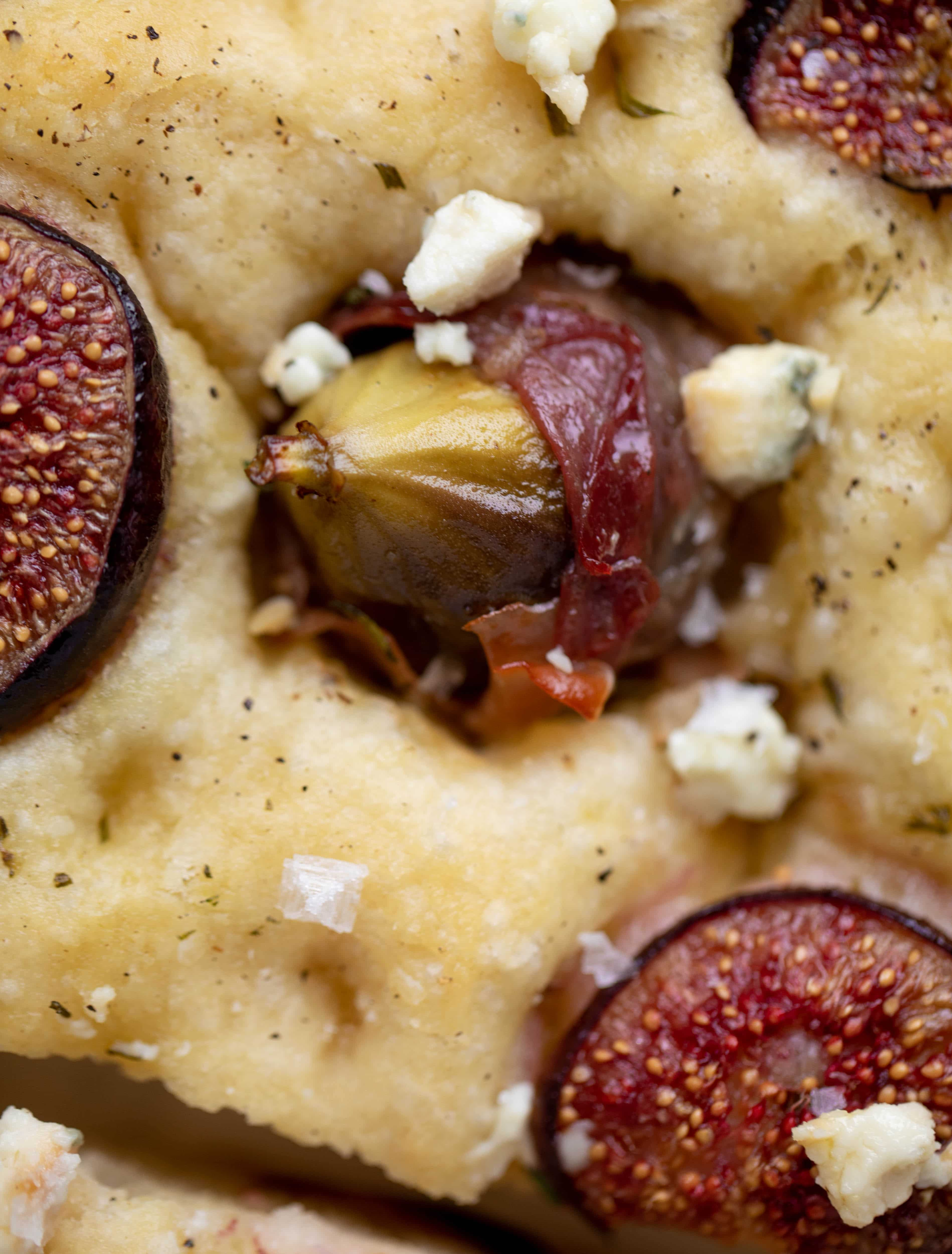 This stuffed fig focaccia bread is such an amazing way to use figs! Golden, toasty, salted focaccia studded with fig jewels. It's delicious and pretty!