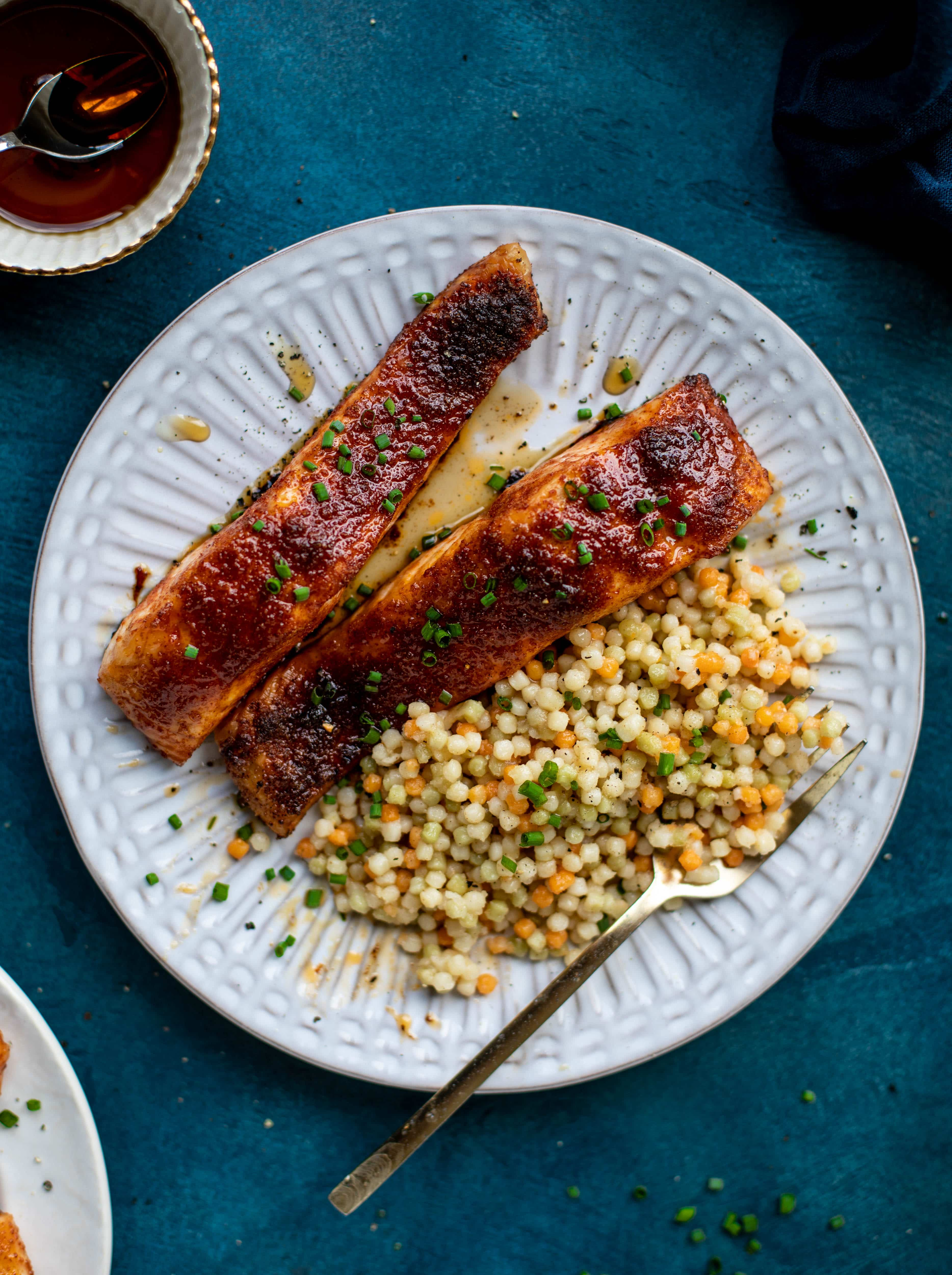 This maple bbq salmon is a quick and delicious weeknight meal. Serve with brown butter couscous and your favorite veg to round it out!
