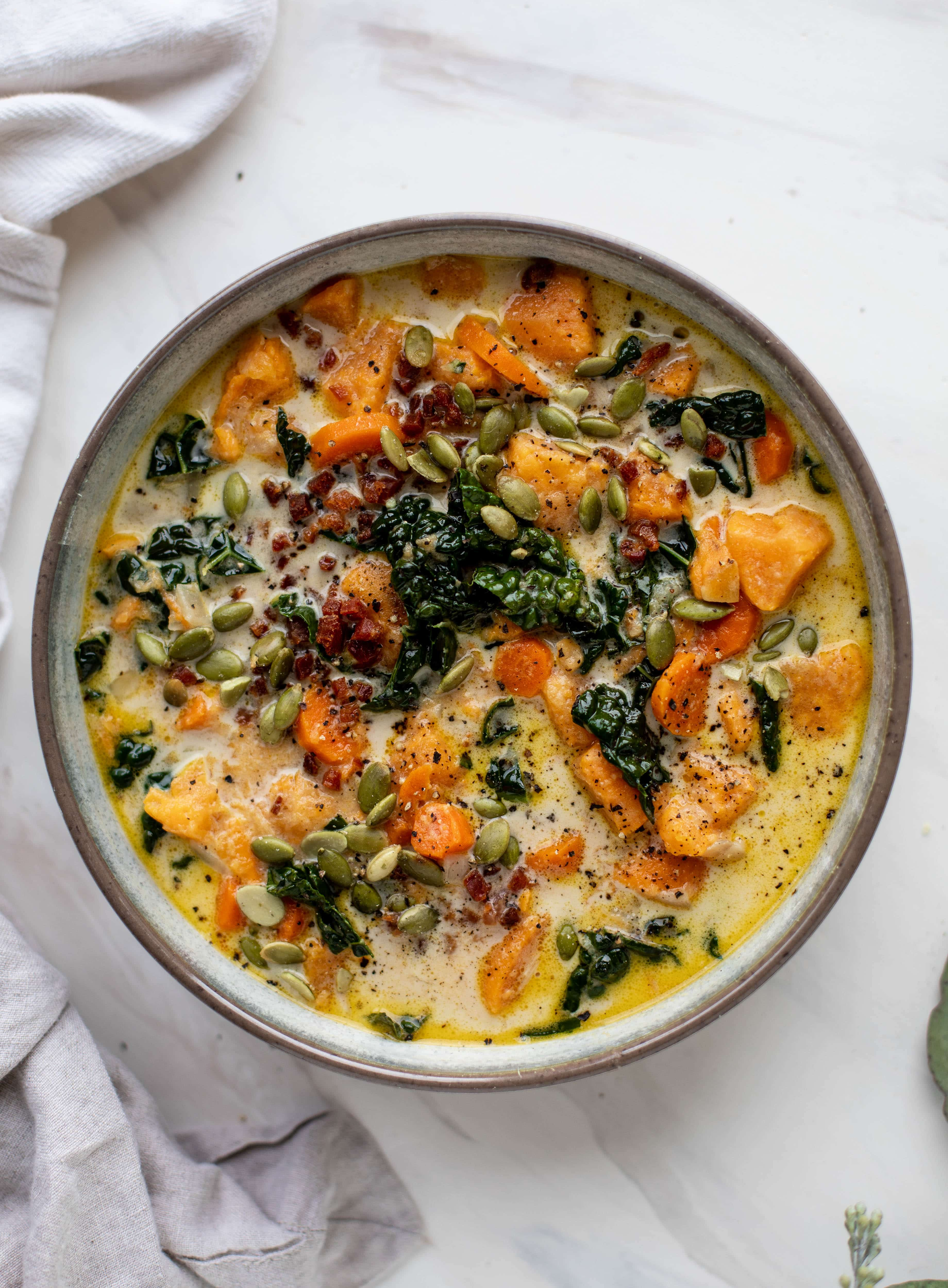 This sweet potato chowder is a hug in a bowl! Made with lots of greens and crunchy pancetta and pepitas for topping, it's a perfect weeknight meal.