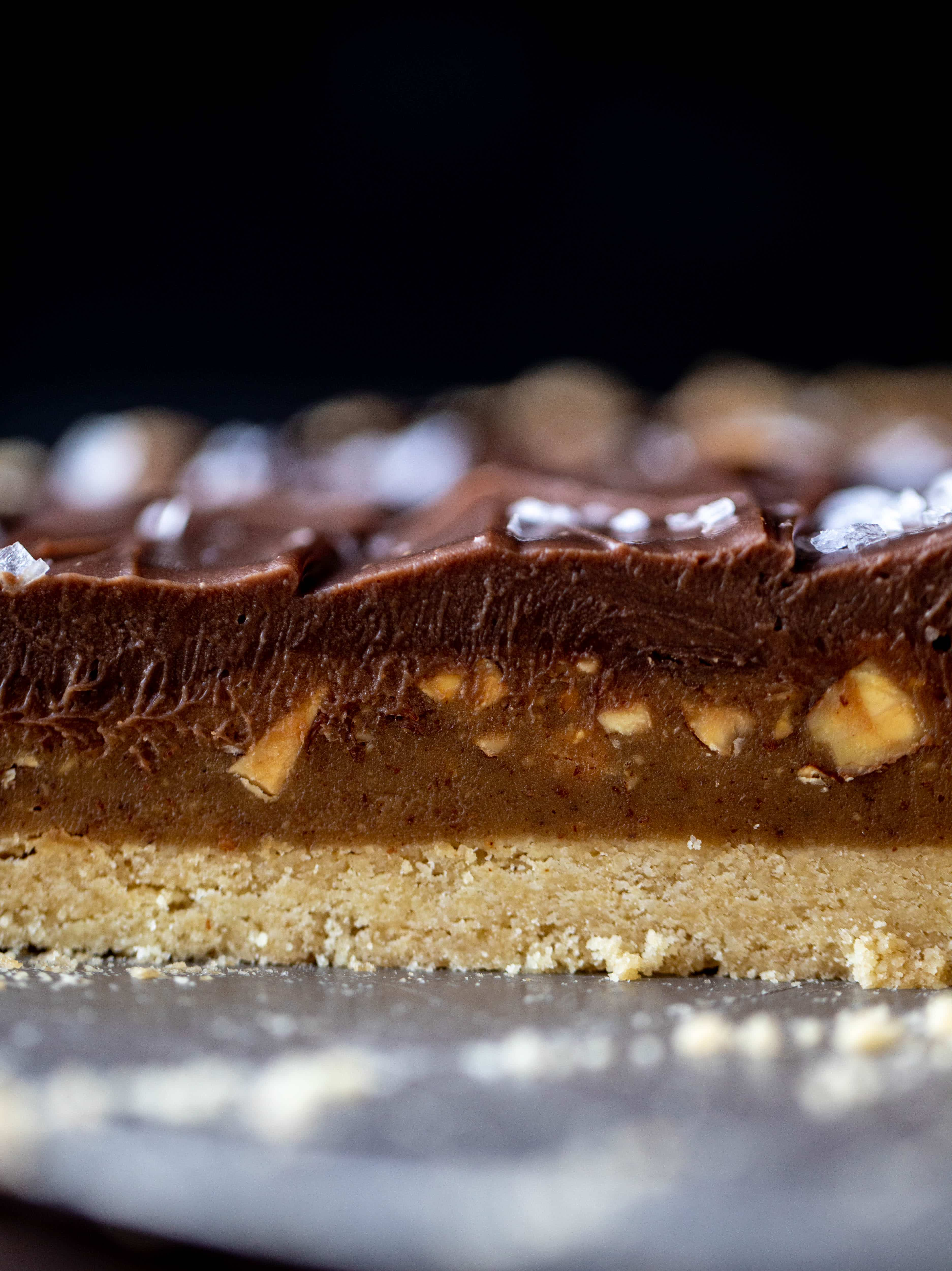 This snickers almond tart is made with an almond crust, homemade almond butter caramel and a chocolate ganache. It's to die for!
