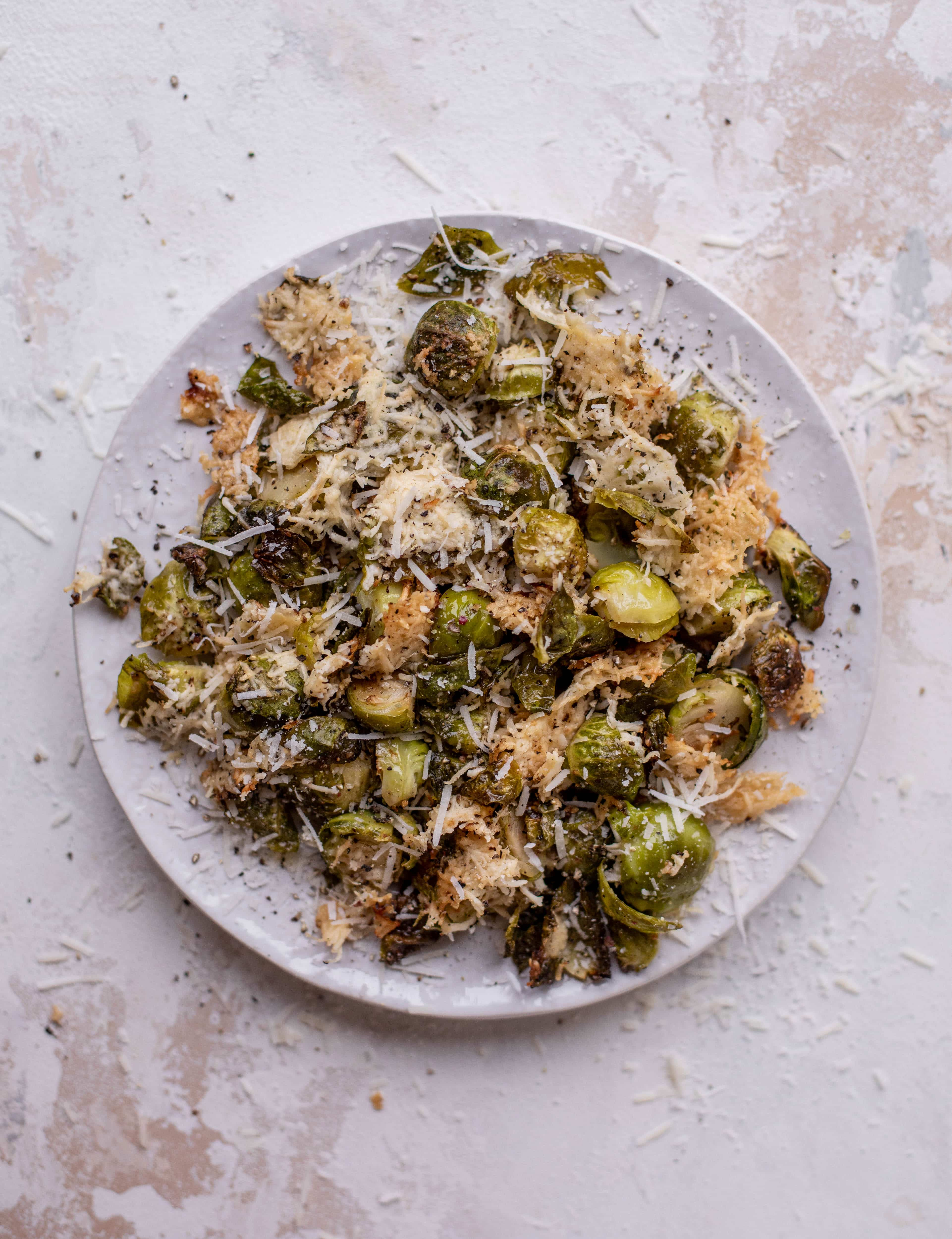 This cacio e pepe brussels are out of the world. Roasted until crisp, topped with tons of black pepper and salty pecorino cheese. Yum.