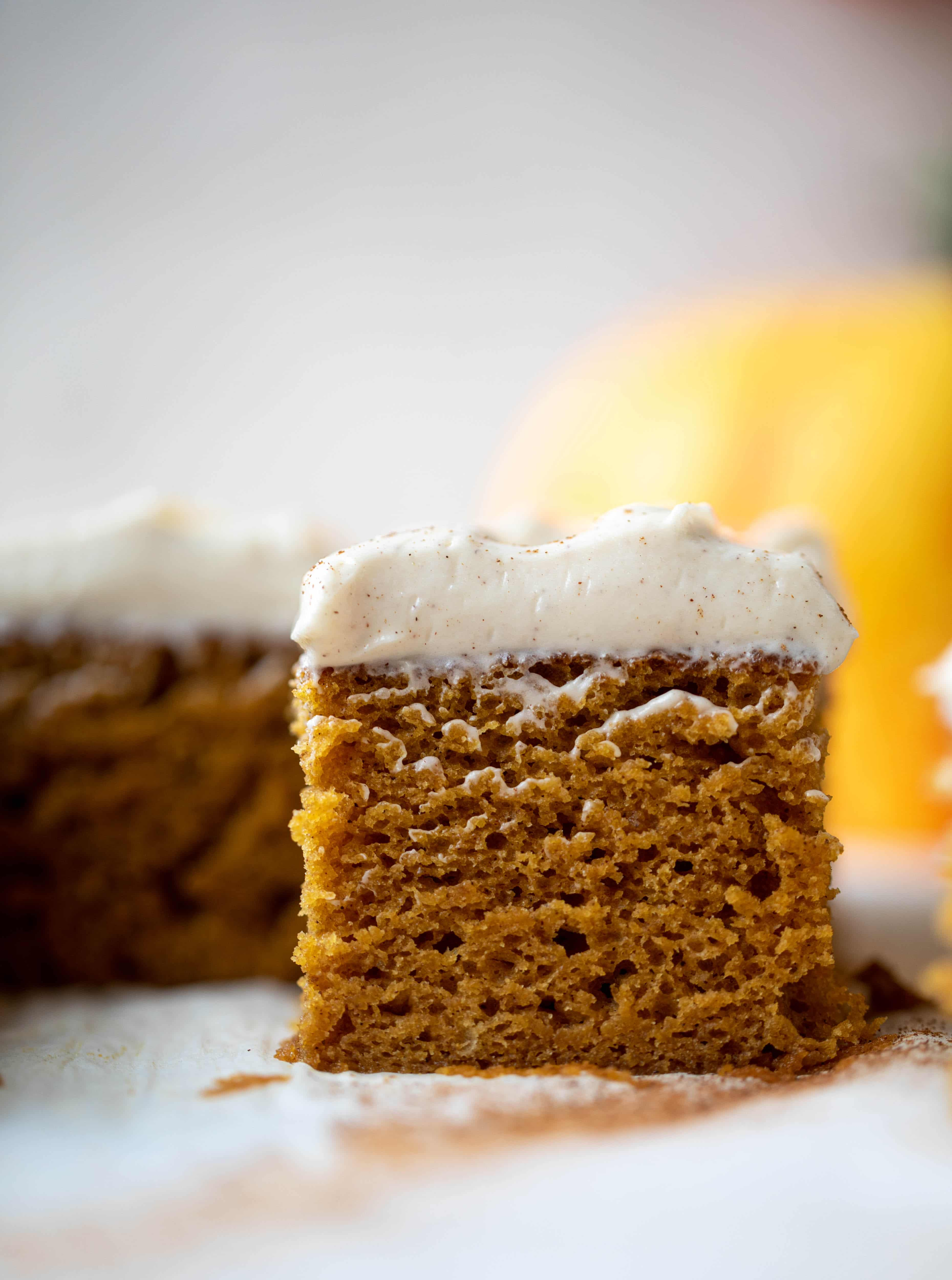 This pumpkin sheet cake is a legit pumpkin dream cake! It's so moist and fluffy and flavorful. With a blanket of cinnamon cream cheese frosting!