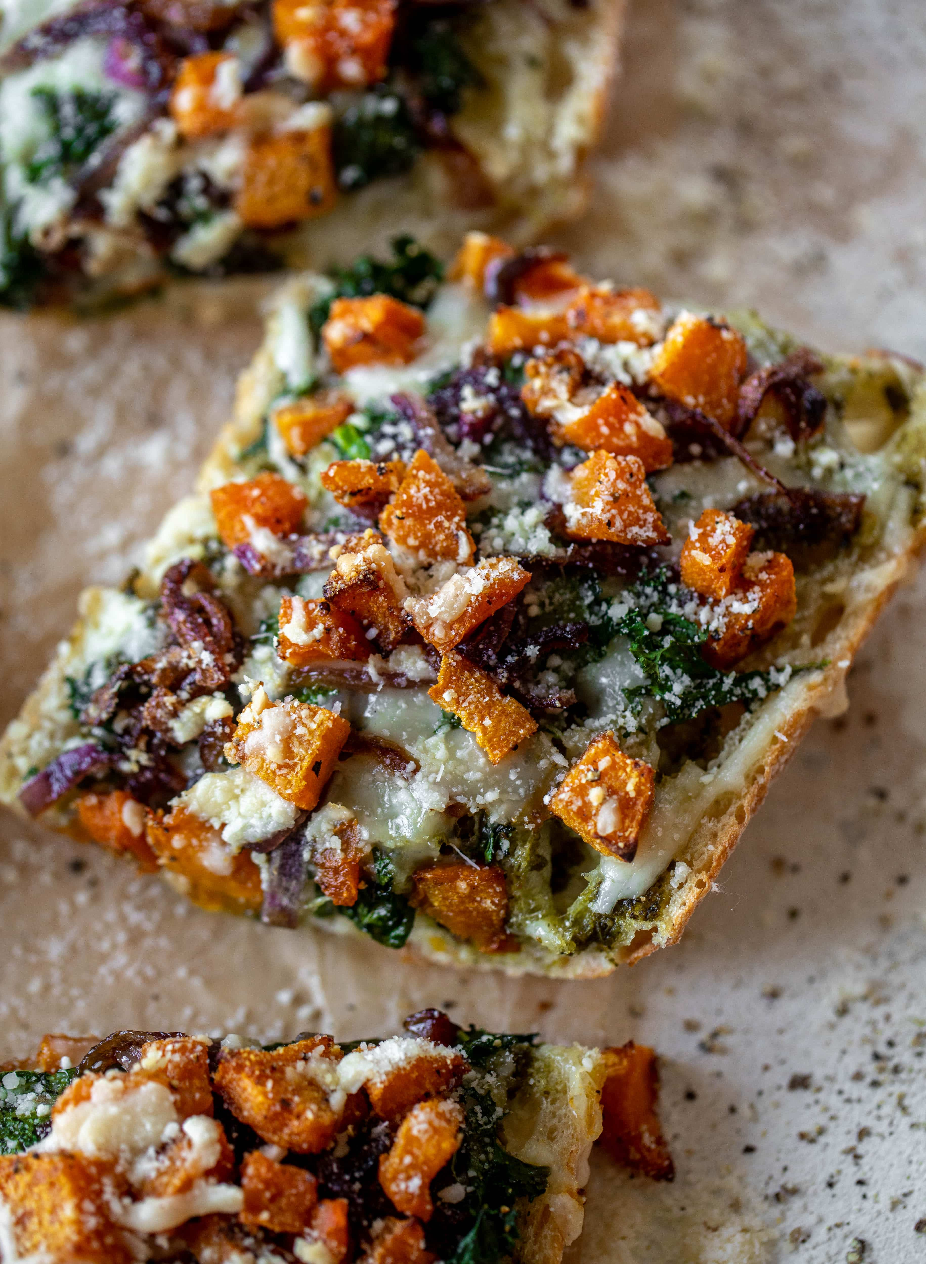 These butternut squash french breads have so much flavor. Pesto, caramelized onions, kale, roasted butternut and tons of fontina cheese. Delicious!